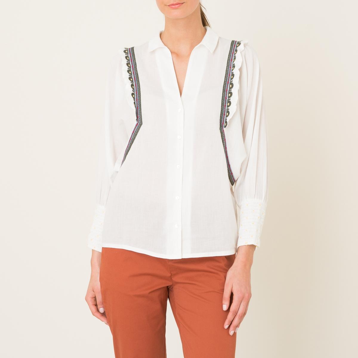 Рубашка JERMAINEРубашка объемная BA&amp;SH - модель JERMAINE из хлопковой вуали . Рубашечный воротник. Застежка на пуговицы спереди. Длинные рукава с напуском и широкими  эластичными манжетами . Отделка вышивкой и воланами Состав и описание    Материал : 100% хлопок   Марка : BA&amp;SH<br><br>Цвет: экрю