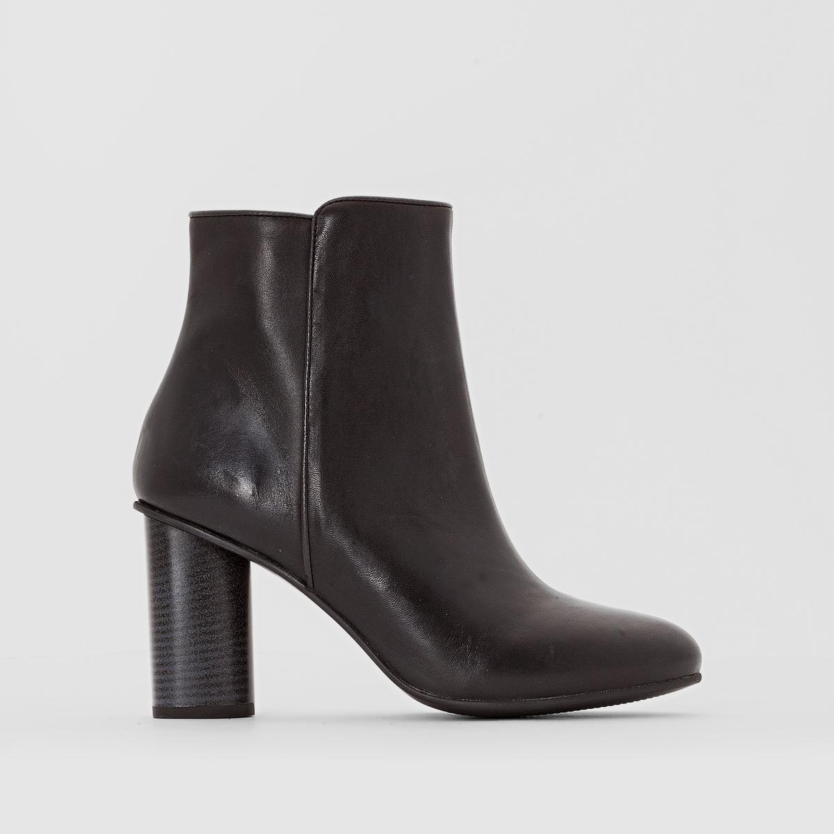 Ботильоны кожаные на высоком каблукеВерх/Голенище: кожа                 Подкладка: кожа         Стелька: кожа         Подошва: эластомер         Высота каблука: 7,5 см                 Форма каблука: широкий         Мысок : закругленный         Застежка : на молнию Страна производства : Португалия<br><br>Цвет: черный<br>Размер: 41