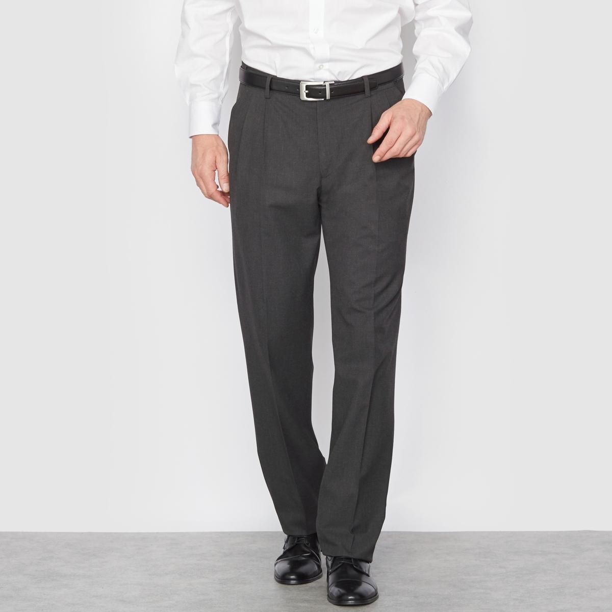 Брюки от костюма с защипами из ткани стретч, длина. 2Брюки можно носить с пиджаком, для создания элегантного и строгого ансамбля, или отдельно.Высококачественная слегка эластичная ткань, 62% полиэстера, 33% вискозы, 5% эластана. Подкладка 100% полиэстер.Длина 2 : при росте от 187 см.  Пояс с потайной регулировкой для максимального комфорта и адаптации к любому обхвату талии. Застежка на молнию, пуговицу и крючок. 2 косых кармана. 1 прорезной карман с пуговицей сзади. Необработанный низ. Длина 2 : при росте от 187 см :- Длина по внутр.шву : 91,8-94,8 см, в зависимости от размера. - Ширина по низу : 21,9-27,9 см, в зависимости от размера. Есть также модель длины 1 : при росте до 187 см. Есть также модель без защипов.<br><br>Цвет: антрацит,темно-синий<br>Размер: 46 (FR) - 52 (RUS).48 (FR) - 54 (RUS).56.60.62.68.52 (FR) - 58 (RUS).62