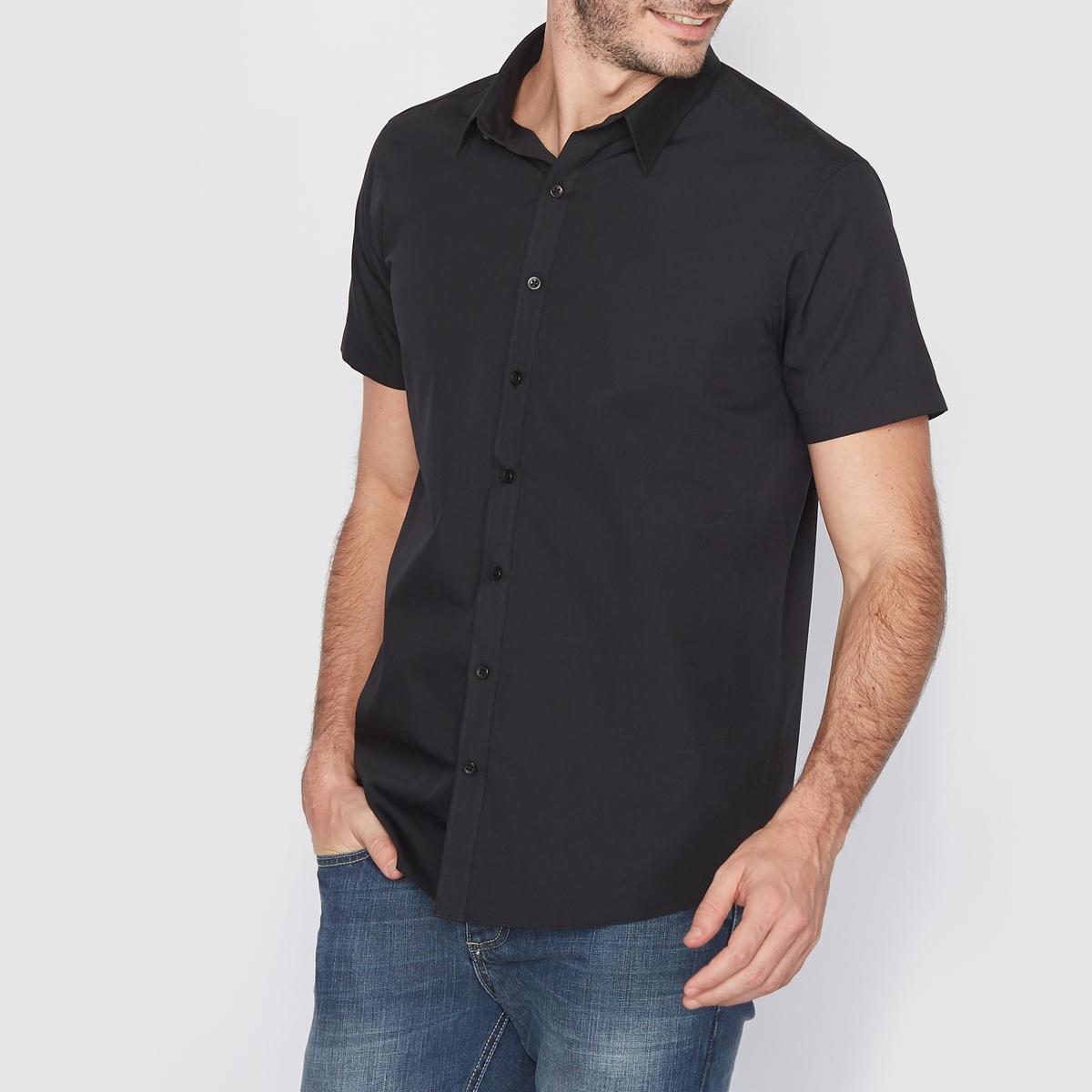 Рубашка однотонная прямого покрояРубашка с короткими рукавами, прямой покрой, воротник со свободными уголками. Длина 77 см. Легкая глажка.Закругленный низ. 55% хлопка, 45% полиэстера.<br><br>Цвет: черный<br>Размер: 35/36
