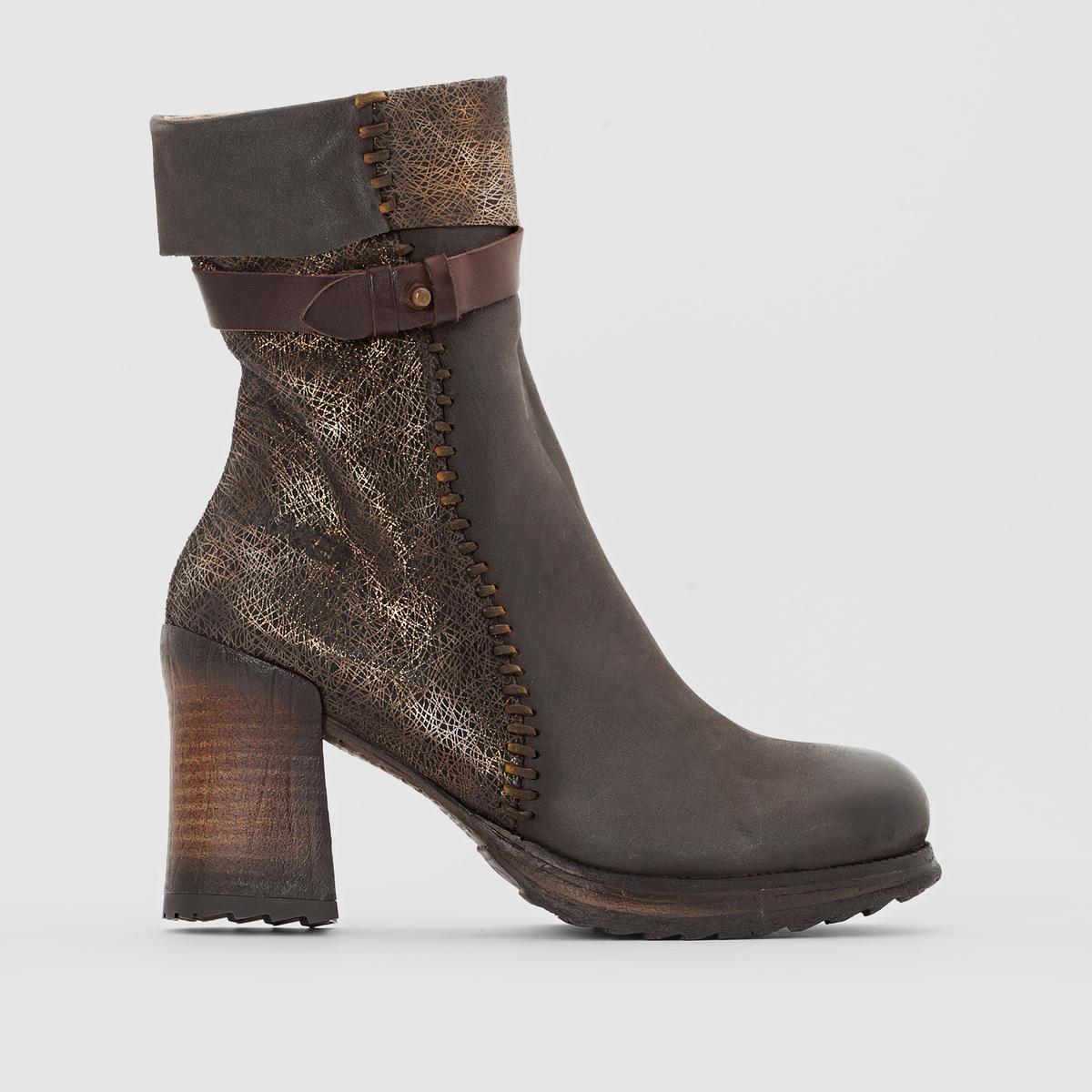 Ботильоны с ремешком FANNYПодкладка : Кожа             Стелька : Кожа    Подошва : каучук.                        Высота каблука : 9 см.   Высота голенища  : 24 см   Форма каблука : широкая  Носок : Закругленный.   Застежка : На молнии<br><br>Цвет: серо-коричневый,черный<br>Размер: 41