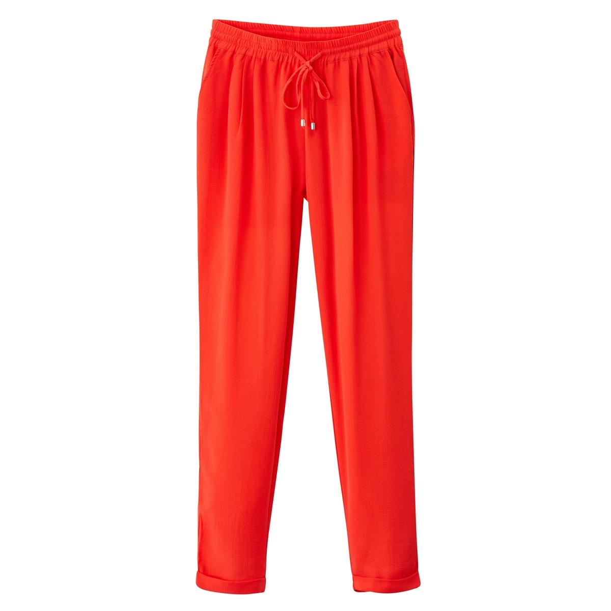 Брюки спортивные из струящейся тканиМатериал : 100% полиэстер Рисунок : однотонная модель  Высота пояса : стандартная Покрой брюк : спортивные брюки<br><br>Цвет: коралловый<br>Размер: M/L