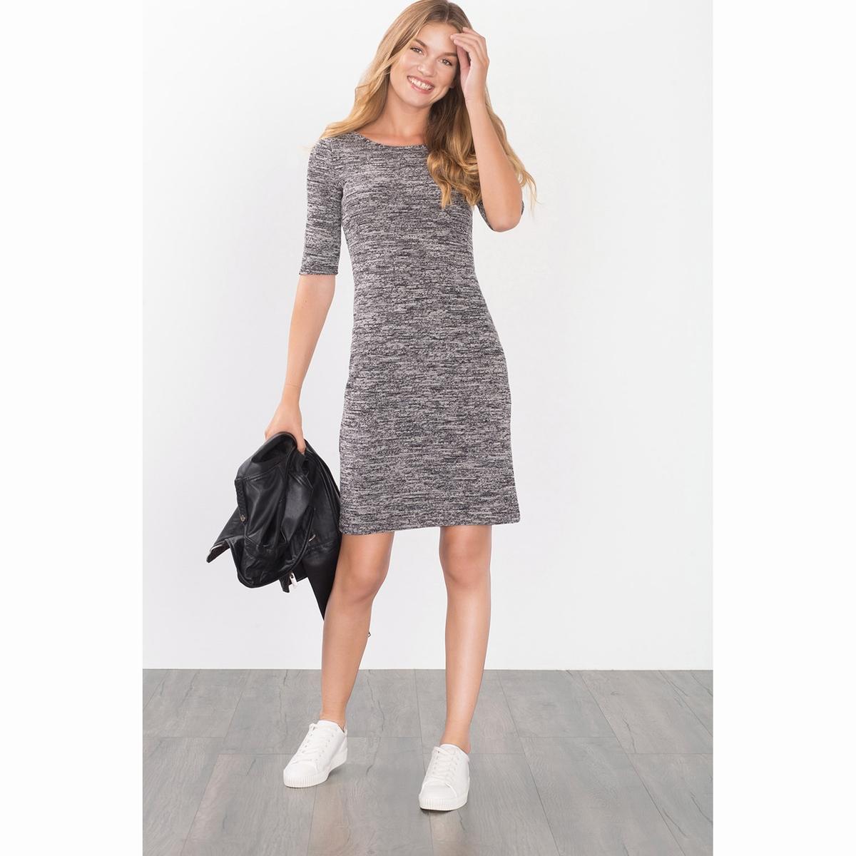 Платье вязаное меланж.Вязаное платье меланж. Рукава ?. Круглый вырез, очень открытая спинка. Состав и описаниеМатериалы: 52% полиэстера, 40% хлопка, 8% эластана.     Марка: EspritУходСледуйте рекомендациям по уходу, указанным на этикетке изделия<br><br>Цвет: черный<br>Размер: XL