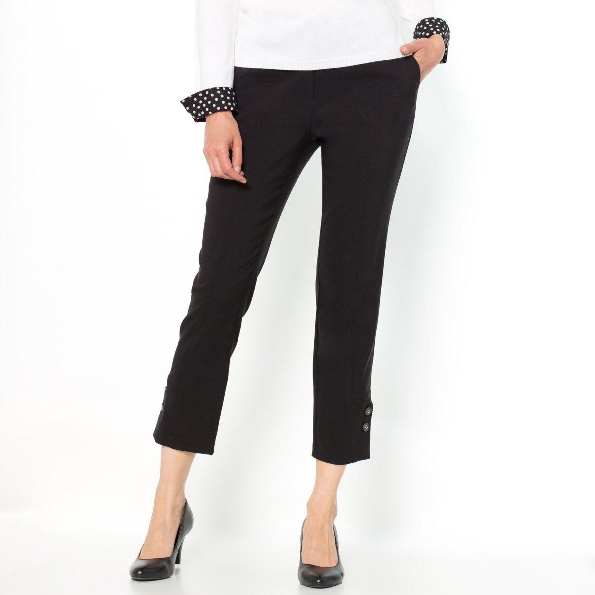 Брюки укороченныеВертикальные швы спереди и сзади делают ноги визуально стройнее. Косые карманы. Боковые разрезы внизу брючин. Длина по внутр.шву 64 см, ширина по низу 16 см. Комфортная ткань стретч, 71% полиэстера, 25% вискозы, 4% эластана.<br><br>Цвет: черный<br>Размер: 46 (FR) - 52 (RUS)