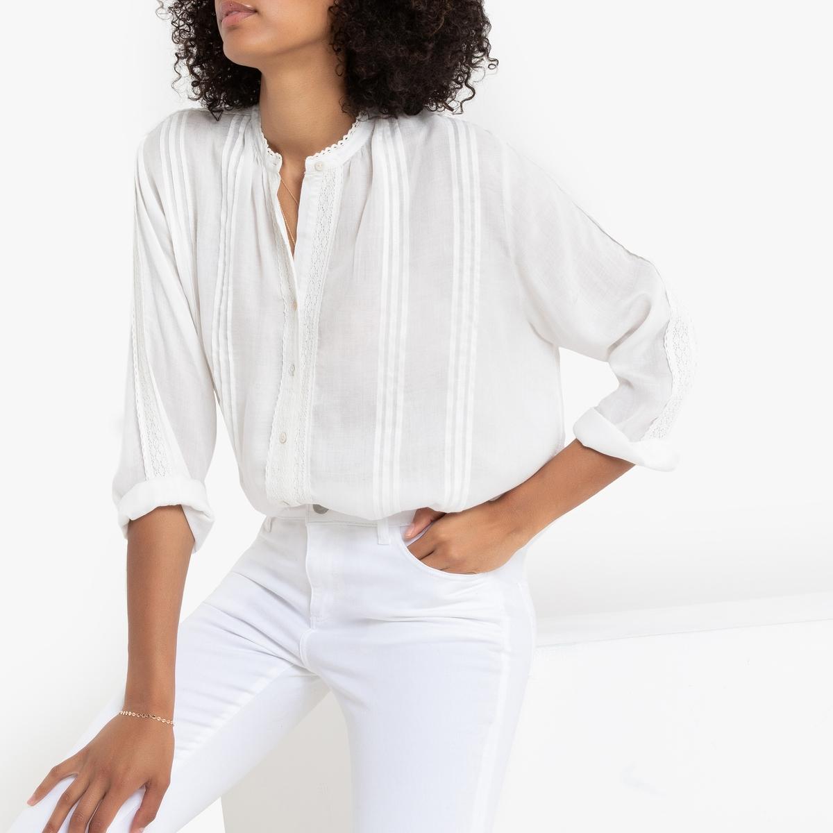 Blusa con cuello redondo y manga larga