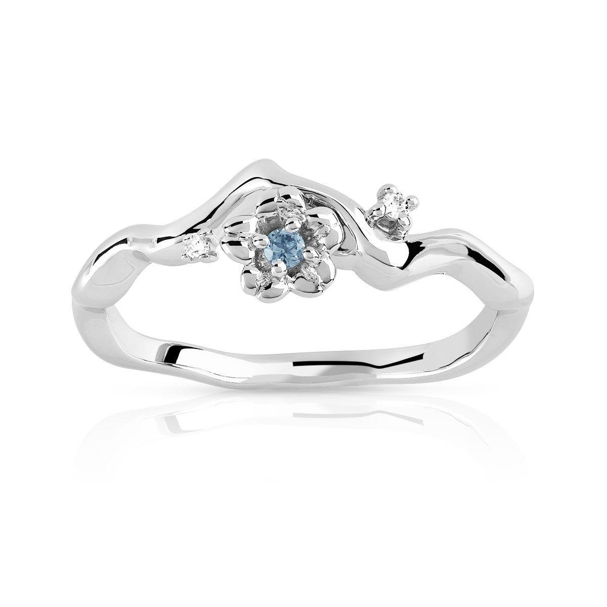 Bague or 375 blanc topaze bleue traitée et diamant