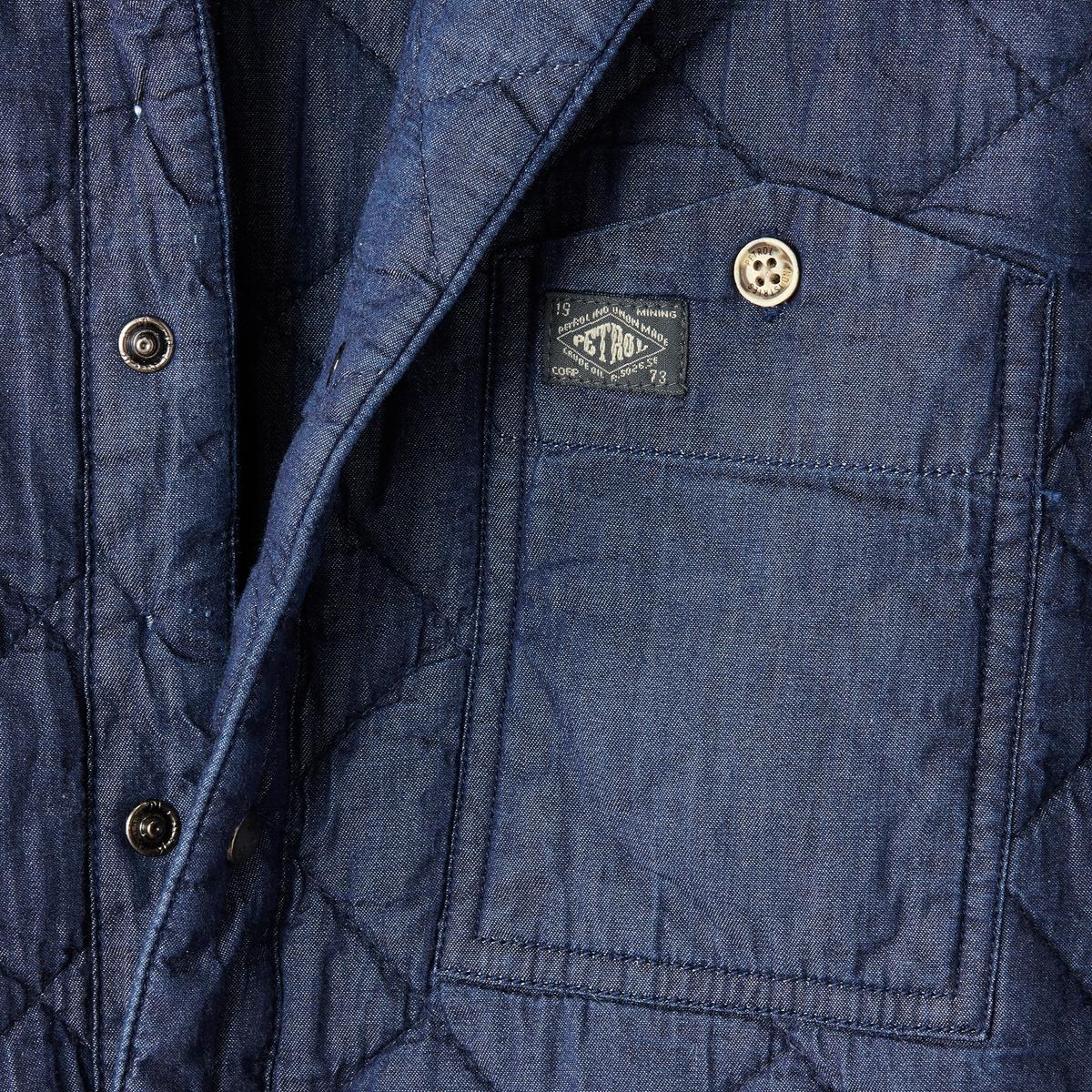Рубашка с длинными рукавамиРубашка с длинными рукавами, PETROL INDUSTRIES.  Прямой покрой, воротник со свободными уголками . Декоративная простежка. Застежка на кнопки. Нагрудный карман с логотипом. Кнопки на манжетах, слегка закругленный низ.Состав и описаниеМатериал : 100% хлопкаМарка : PETROL INDUSTRIES<br><br>Цвет: темно-синий<br>Размер: S