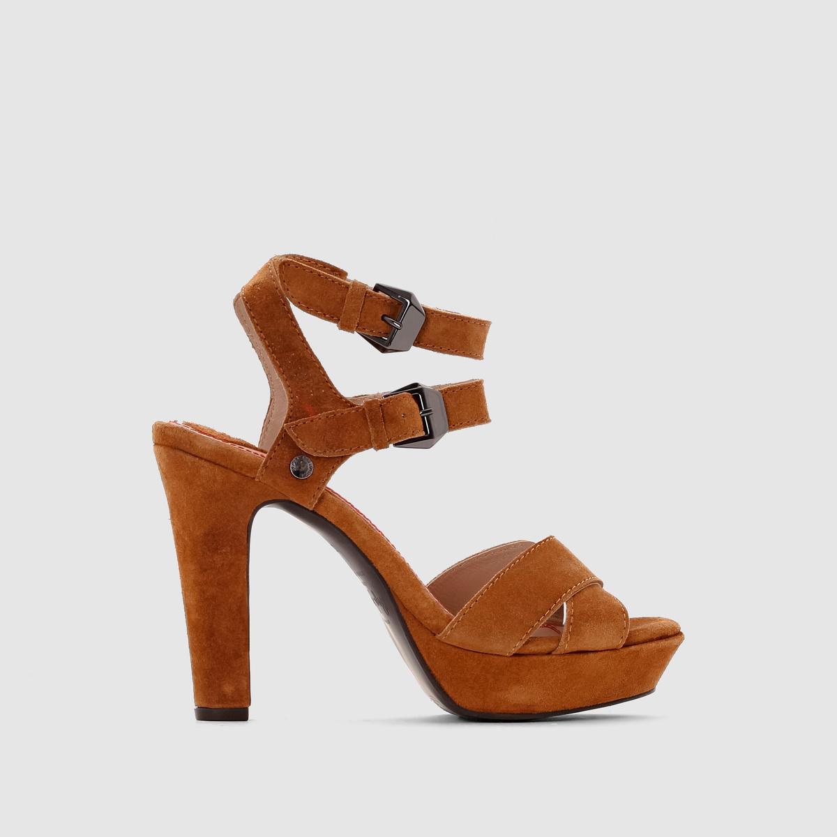 Босоножки Andy WoodБосоножки из кожи на каблукеAndy WoodWOOD PEPE JEANS      Верх  : замша, яловичная кожа   Подкладка  : козья кожаСтелька  : кожа.   Подошва  : из эластомера. Застежка   : ремешок с пряжкой.Высота каблука   : 11 см  Замша, очень женственные ремешки, облегающие ногу, оптимальная высота каблука и дизайн в стиле рок  :  стиль от Pepe Jeans виден с первого взгляда, наслаждайтесь им все лето напролет  !<br><br>Цвет: темно-коричневый