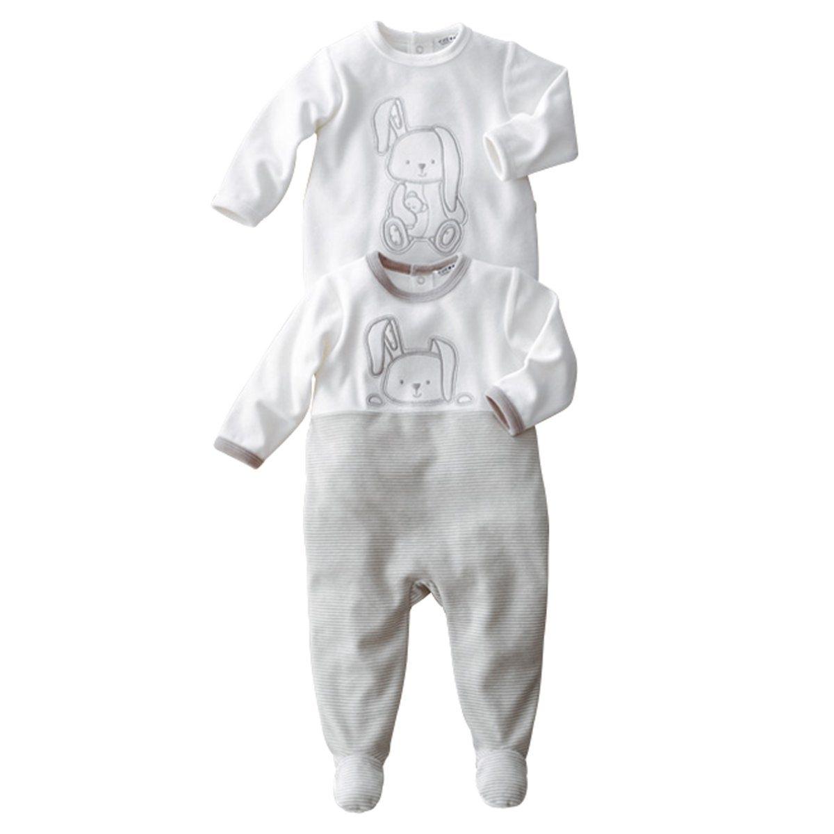 Пижама с носочками, 0 месяцев -3 года (компленкт из 2)Пижама с носочками из очень мягкого и теплого велюра . Вышитая аппликация спереди и сзади. Застжека на кнопки на спине. Покрытие против скольжения на ступнях начиная от 74 см (1 год), эластичные вставки сзади для лучшей поддержки.Знак марки отпечатан с внутренней стороны и не напечатан на пришитой этикетке сзади, чтобы не вызвать раздражение или зуд на коже ребенка .Состав и описание : Материал: велюр, 75% хлопка, 25% полиэстера.Уход: :Машинная стирка при 30 °C на умеренном режиме с вещами схожих цветов.Стирать, сушить и гладить с изнаночной стороны.Машинная сушка в умеренном режиме.Гладить на низкой температуре.<br><br>Цвет: белый<br>Размер: 9 мес. - 71 см.1 год - 74 см.18 мес. - 81 см.2 года - 86 см.3 года - 94 см