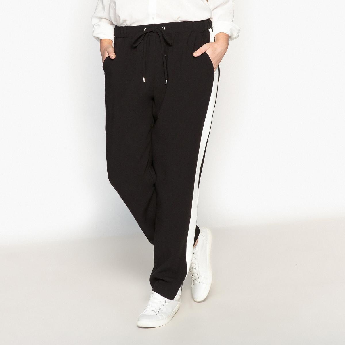 Брюки с полосками по бокамОписание:Струящиеся брюки в изящном спортивном стиле с контрастными полосками по бокам. Стильные и комфортные благодаря эластичному поясу брюки.Детали •  Узкие, дудочки •  Стандартная высота пояса •  Эластичный поясСостав и уход •  36% вискозы, 4% эластана, 60% полиэстера •  Температура стирки 30°   •  Сухая чистка и отбеливание запрещены •  Не использовать барабанную сушку   •  Низкая температура глажки   ВАЖНО: Товар без манжетТовар из коллекции больших размеров •  Контрастные полоски по бокам. •  Длина по внутр.шву 78 см, ширина по низу 20,5 см<br><br>Цвет: хаки,черный<br>Размер: 48 (FR) - 54 (RUS).44 (FR) - 50 (RUS).46 (FR) - 52 (RUS).50 (FR) - 56 (RUS)