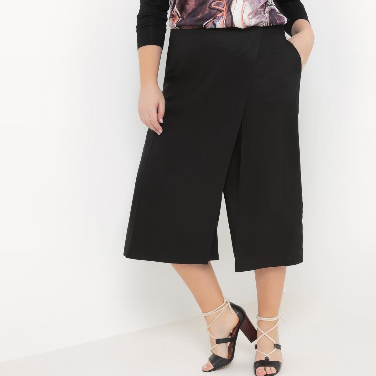 Юбка-брюкиЮбка-брюки Mellem из тенсела, вставка спереди для имитации юбки. Эластичный пояс, регулируемый сзади. 100% вискоза<br><br>Цвет: черный<br>Размер: 52 (FR) - 58 (RUS)