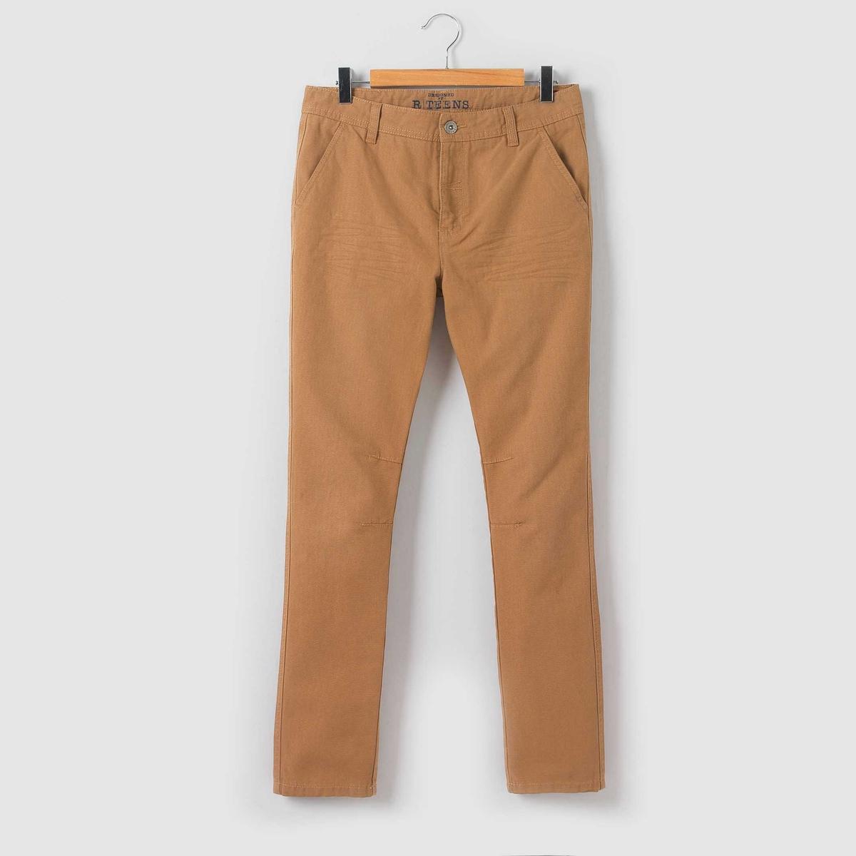 Брюки зауженные, 10-16 летЗауженные брюки, пояс со шлевками, регулируется внутренней резинкой на пуговице . Застежка на молнию и пуговицу. 2 кармана спереди и 2 прорезных кармана сзади. Заложенные складки спереди и сзади. Состав и описание : Материал        саржа стретч,  98% хлопка, 2% эластанаУход :Машинная стирка при 30 °C с вещами схожих цветов.Стирать и гладить с изнаночной стороны.Машинная сушка в умеренном режиме.Гладить при средней температуре.<br><br>Цвет: бежевый<br>Размер: 14 лет