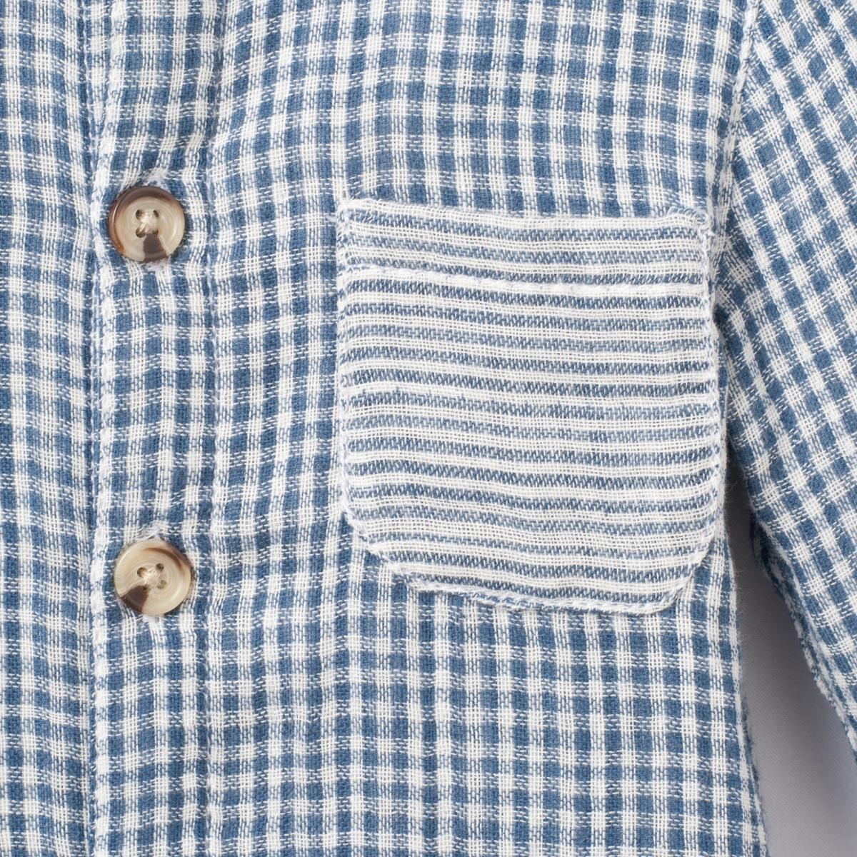 Рубашка в клетку, 1 мес. - 3 годаРубашка с длинными рукавами в клетку . Воротник-стойка. Накладной карман в полоску. Застежка на пуговицы спереди. Манжеты застегиваются на пуговицу. Внутренняя поверхность рубашки в полоску.Состав и описаниеМатериал       100% хлопкаМарка       R essentielУходСтирка и глажка с изнаночной стороныМашинная стирка при 30 °С в умеренном режиме с вещами схожих цветовМашинная сушка запрещенаГладитьпри умереннойтемпературе<br><br>Цвет: в клетку  синий/ белый<br>Размер: 1 мес. - 54 см