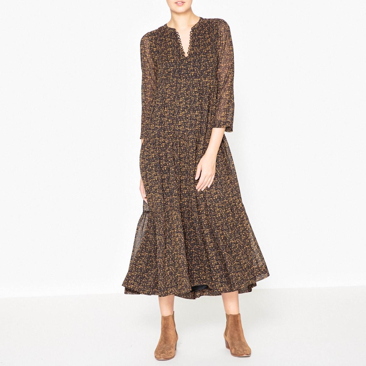 Платье длинное с рисунком AZALEAДлинное платье с длинными рукавами STELLA FOREST - AZALEA из 100% вискозы с рисунком, свободный покрой.Детали •  Форма : МАКСИ •  Длина ниже колен •  Рукава 3/4    •   V-образный вырез •  Рисунок-принтСостав и уход •  100% вискоза •  Следуйте советам по уходу, указанным на этикетке •  Оригинальные детали на вырезе •  Свободный, расширяющийся книзу покрой •  Длина ок. 126 см. для размера 36<br><br>Цвет: темно-синий