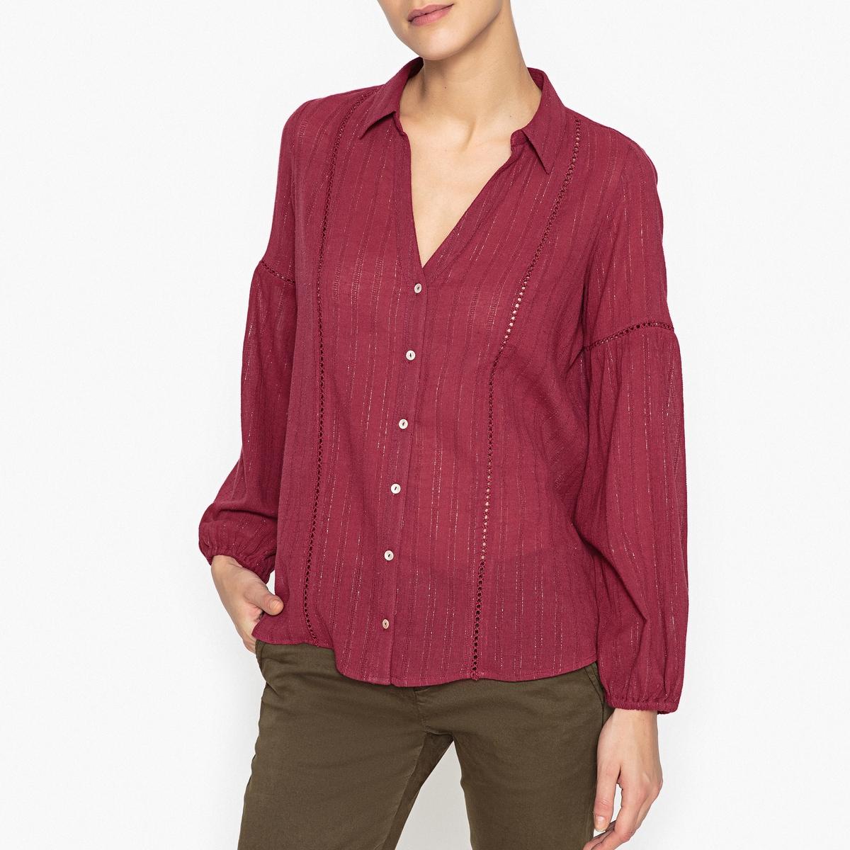 Рубашка блестящая LAKOTAОписание:Блестящая рубашка BA&amp;SH - модель LAKOTA с мережками и перламутровыми пуговицами.Детали  •  Длинные рукава •  Прямой покрой •  Воротник-поло, рубашечныйСостав и уход  •  98% хлопка, 2% металлизированного волокна •  Следуйте рекомендациям по уходу, указанным на этикетке изделия •  Эластичные манжеты •  Перламутровые пуговицы •  Мережки на рукавах •  V-образный вырез и рубашечный воротник<br><br>Цвет: сливовый<br>Размер: L