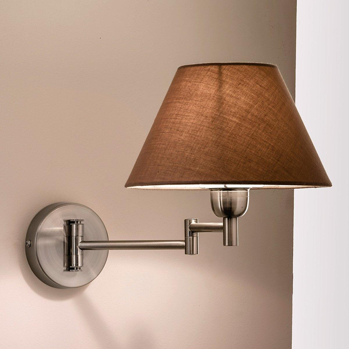 Светильник настенный, NynaОписание светильника, Nyna:1 гибкая лапка Абажур серо-коричневого цвета Патрон E14 для лампочки 40W.  (не входит в комплект)   В комплекте крепежная система.Этот светильник совместим с лампочками    энергетического класса   : A-B-C-D-EХарактеристики светильника, Nyna:1 лапка из алюминия Абажур из хлопка Размеры настенного светильника, Nyna:Абажур: Диаметр внизу: 21,5 см, диаметр сверху: 10 см. Высота: 13,5 см.Общие размеры:В разложенном виде:Ширина: 21,5 смВысота: 60 смГлубина: 40 смВ сложенном виде: Ширина: 24 смВысота: 60 смГлубина: 22,5 см<br><br>Цвет: потертый алюминий