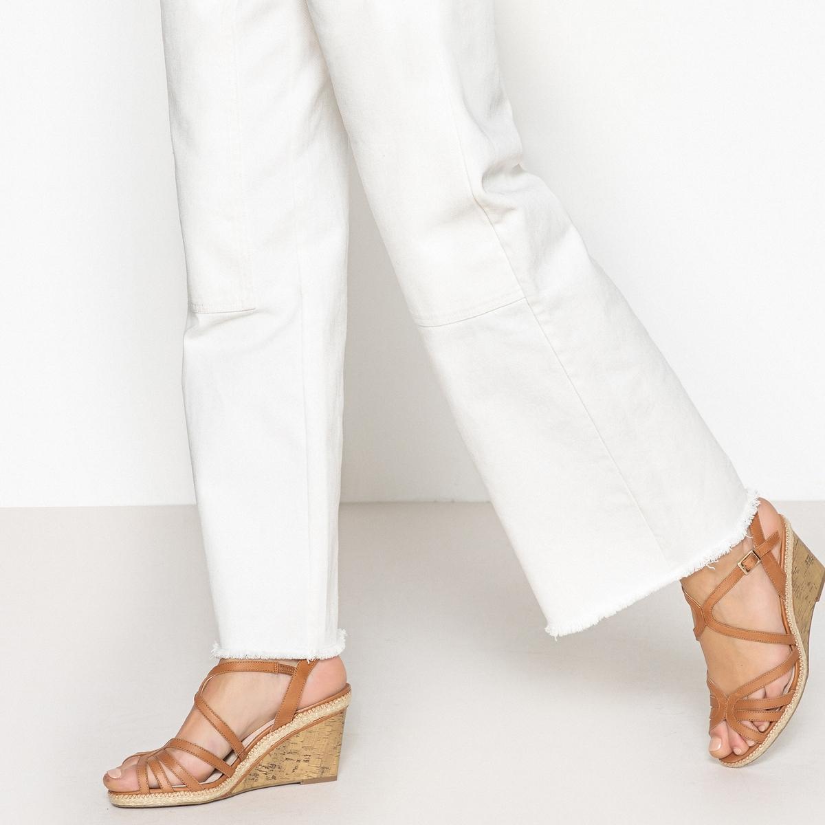 Zapatos de piel con tacón de cuña efecto corcho