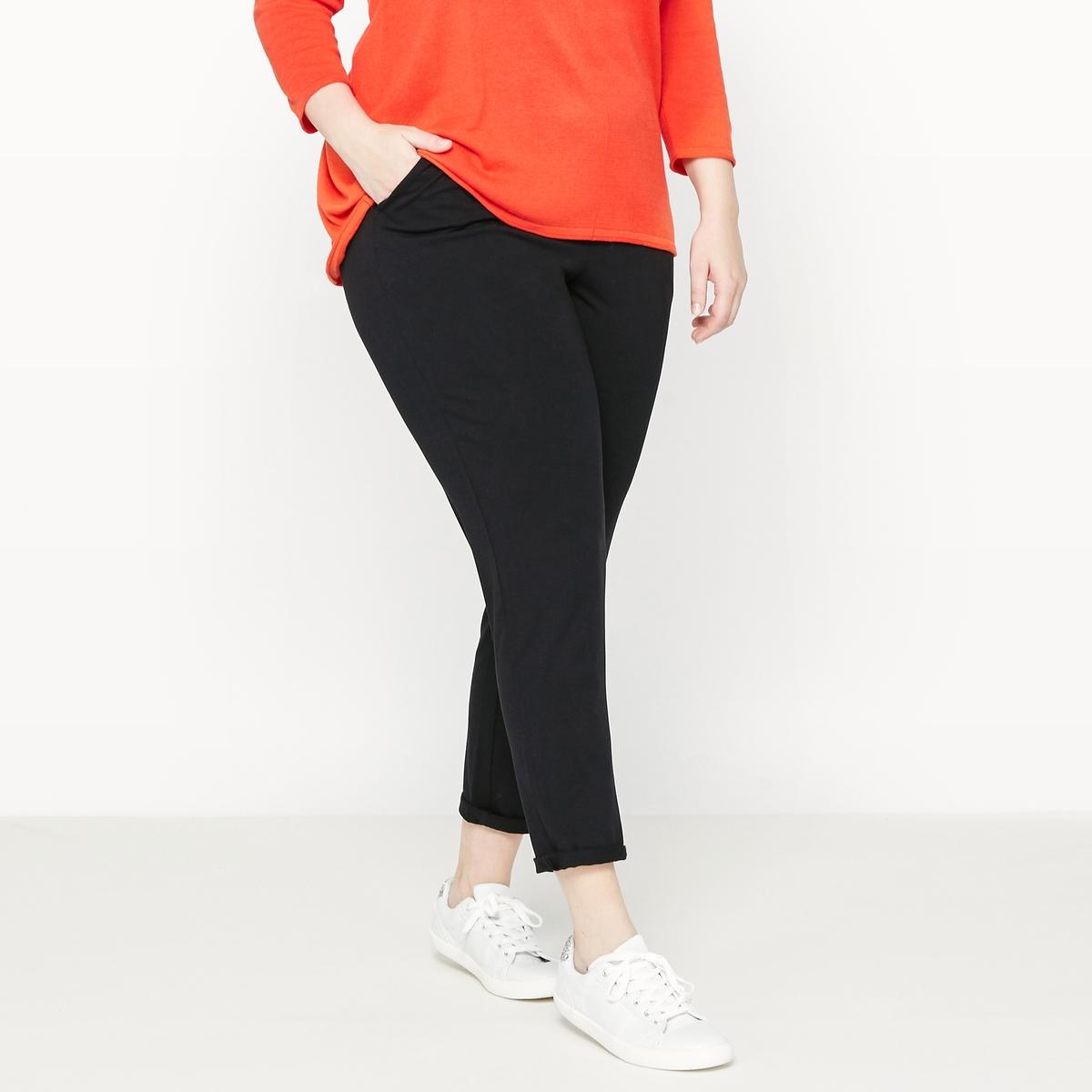 Брюки спортивные струящиеся из джерсиБрюки. Спортивные брюки из струящегося материала приятные на ощупь и очень удобные! 2 кармана по бокам. Пояс на резинке даёт свободу движениям . Брючины заужены книзу. Однотонный чёрный джерси: 95% вискозы, 5% эластана. Длина по внутр.шву 72 см.<br><br>Цвет: красно-коричневый,темно-синий,черный<br>Размер: 42 (FR) - 48 (RUS).42 (FR) - 48 (RUS).58 (FR) - 64 (RUS).54 (FR) - 60 (RUS).52 (FR) - 58 (RUS)