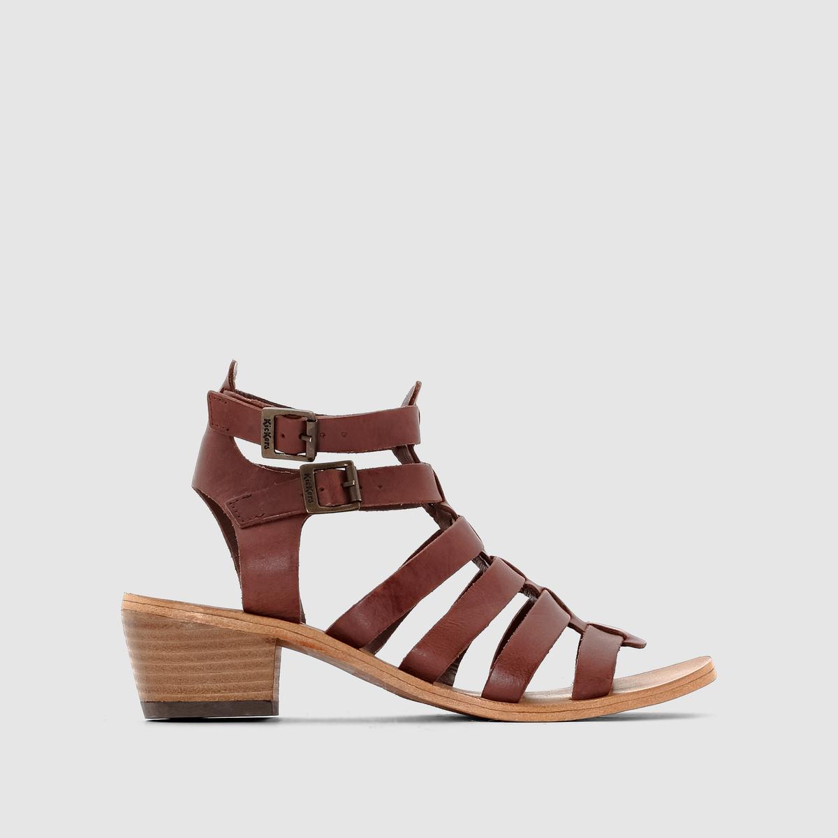 Босоножки кожаные на каблуке KhoalaБосоножки на каблуке KICKERS, модель Khoala. Верх: яловичная кожа.Подкладка: кожа.Стелька: невыделанная кожа.Подошва: эластомер.Застежка: двойной регулируемый ремешок с застежкой на щиколотке.Высота каблука: 5 см. Вам понравятся эти оригинальные босоножки Kickers в стиле римских сандалий: женственные и очень удобные благодаря устойчивому каблуку квадратной формы. Идеальное дополнение вашего образа!<br><br>Цвет: каштановый<br>Размер: 40
