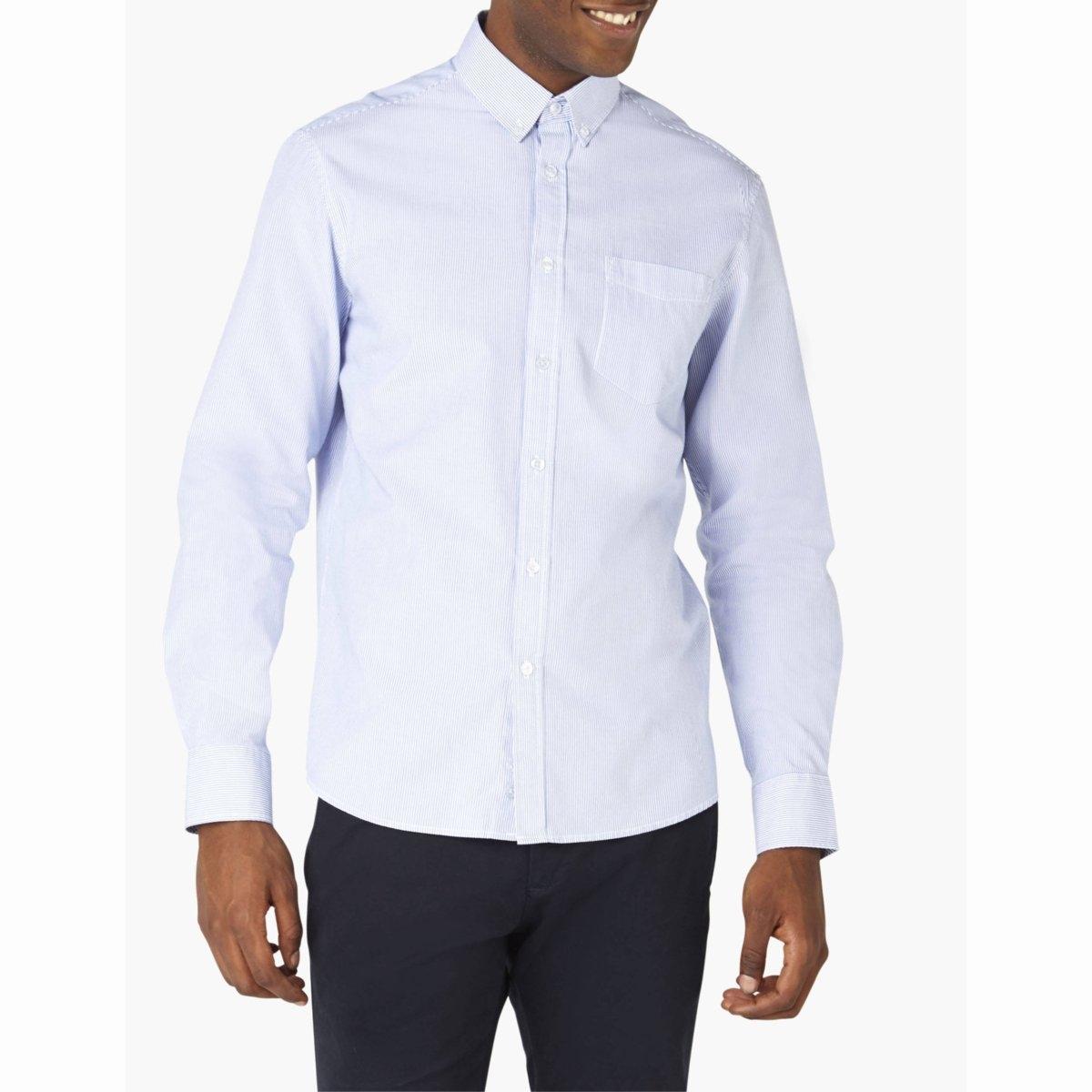 Рубашка CALINE, 100% хлопкаРубашка CALINE - CELIO. Длинные рукава. Уголки воротника на пуговицах. Низ рукавов с пуговицами. 1 накладной нагрудный карман. Закругленный низ.Рубашка, 100% хлопка.<br><br>Цвет: синий