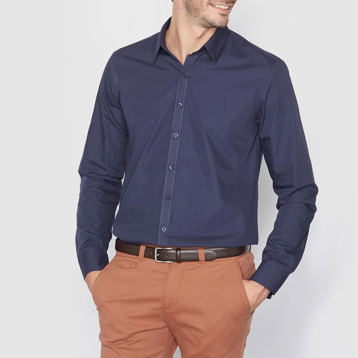Рубашка однотонная прямого покрояРубашка прямого покроя с длинными рукавами. Длина 77 см.   Легкая глажка.Низ рукавов с застежкой на пуговицы. 55% хлопка, 45% полиэстера.<br><br>Цвет: небесно-голубой,темно-синий,черный<br>Размер: 41/42.43/44.47/48.35/36.37/38.41/42.43/44.37/38.39/40.43/44