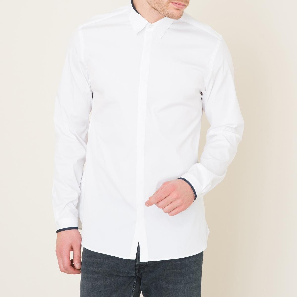 Рубашка классическая однотоннаяРубашка белая THE KOOPLES - классический покрой с контрастной отделкой . Рубашечный воротник и манжеты на подкладке с контрастной отделкой . Скрытая планка застежки на пуговицы. Длинные рукава, манжеты с застежкой на пуговицу.Состав и описание:    Материал : 78% хлопка, 18% полиамида, 4% эластана   Вставки 100% полиэстер  Марка : THE KOOPLES<br><br>Цвет: белый
