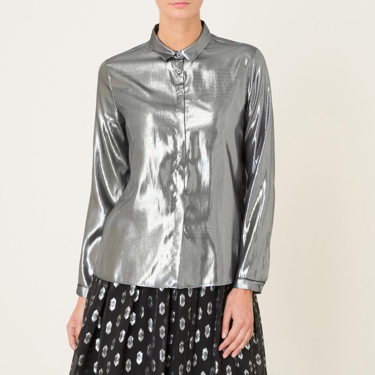Рубашка шелковаяРубашка POMANDERE - из шелка и серебристого люрекса. Свободные уголки воротника. Супатная застёжка на пуговицы. Длинные рукава с пуговицами на манжетах. Прямой покрой.Состав и описание Материал : 73% шелка, 27% металлизированных волокон люрексаМарка : POMANDERE<br><br>Цвет: серебристый<br>Размер: 40 (FR) - 46 (RUS)