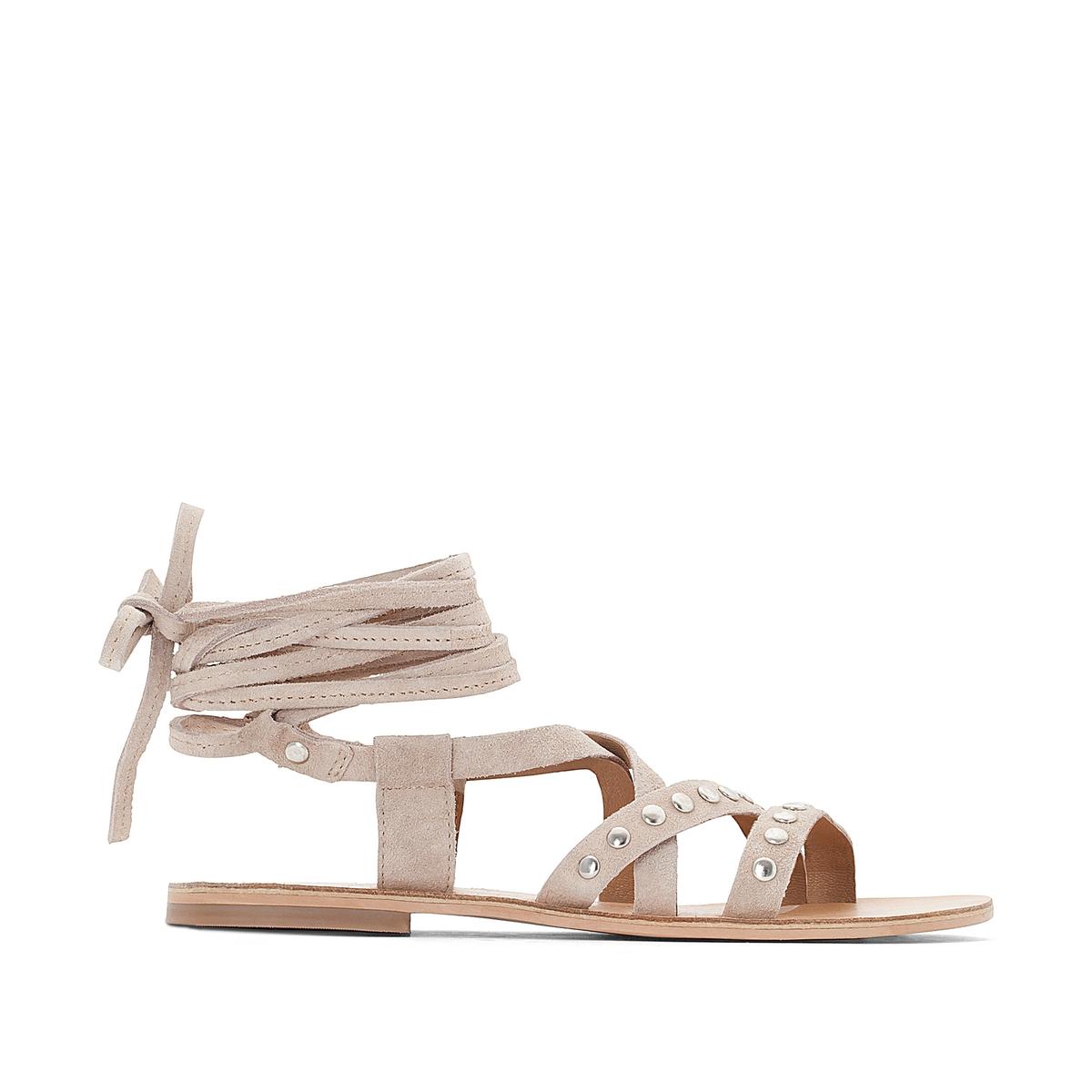 Босоножки кожаные с металлической деталью на плоском каблуке