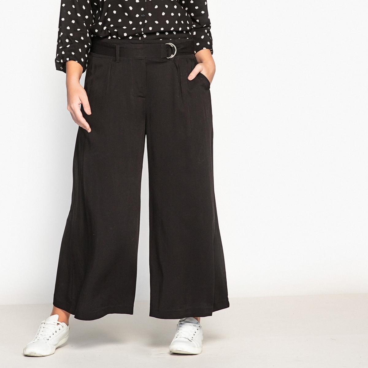 Брюки свободные, широкиеОписание:Красивые широкие брюки в стиле 70-х годов. Укороченные широкие брюки идеально смотрятся с кедами, создавая образ в изящном и свободном стиле.Детали •  Широкий покрой   •  Стандартная высота пояса •  Регулируемый пояс Состав и уход •  100% вискоза •  Температура стирки 30°   •  Сухая чистка и отбеливание запрещены •  Не использовать барабанную сушку   •  Низкая температура глажки Товар из коллекции больших размеров •  2 боковых кармана. •  Длина по внутр.шву 60 см, ширина по низу 46,8 см<br><br>Цвет: черный<br>Размер: 50 (FR) - 56 (RUS).46 (FR) - 52 (RUS).48 (FR) - 54 (RUS)