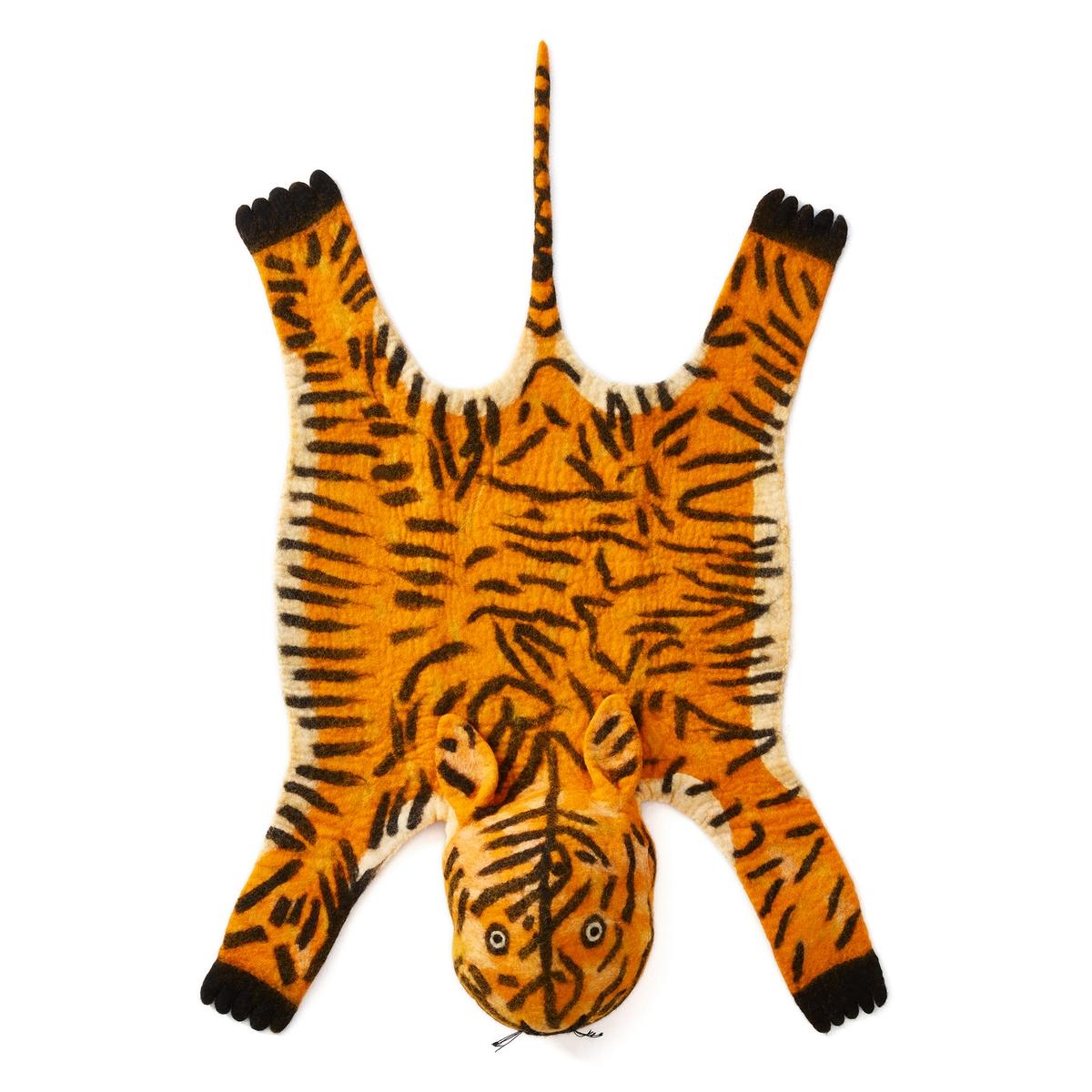 Ковер в форме шкуры тигра SaskiaКовер Saskia. Оригинальный и забавный ковер идеально впишется в интерьер детской комнаты! 100% шерсть. Вес : 1000 г/м?. Толщина ворса : 30 - 35 мм. Размер : ширина 60 x длина 110 см.<br><br>Цвет: оранжевый