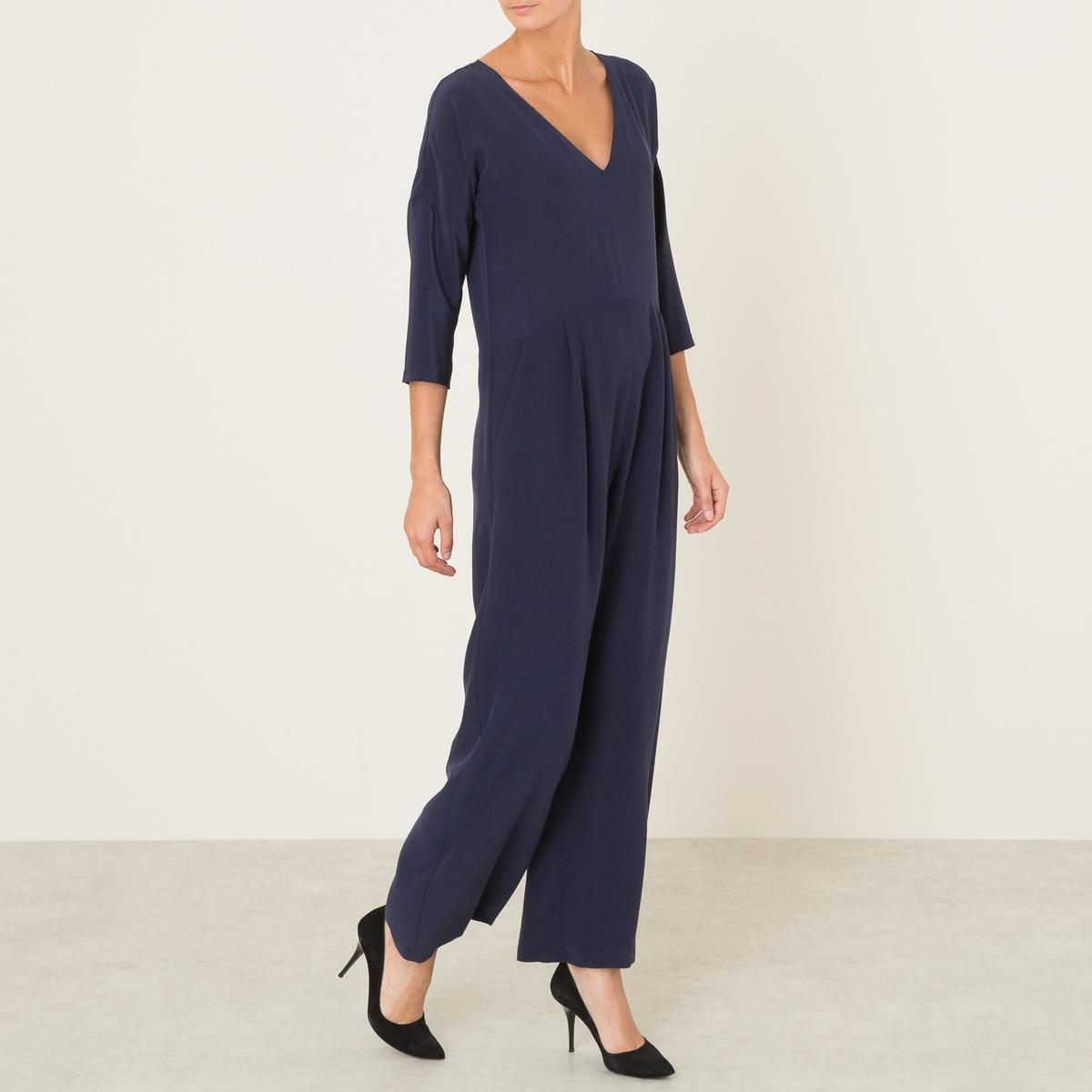 Комбинезон с брюками ERICE BISСостав и описание :Материал : 100% шелкМарка : MOMONI<br><br>Цвет: темно-синий