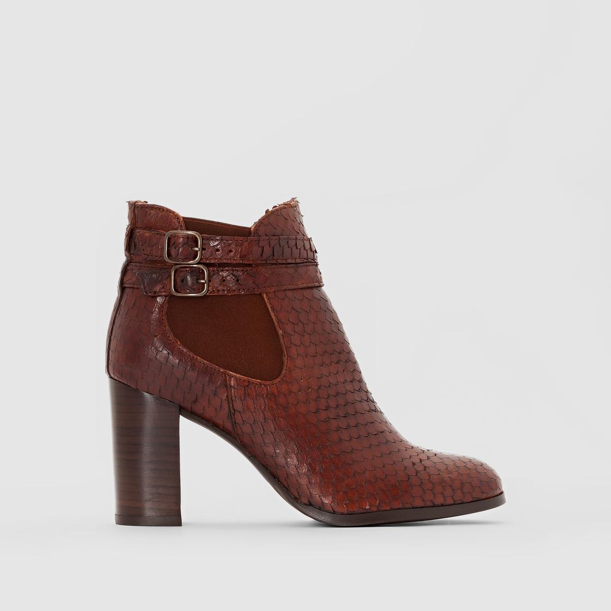 Ботинки кожаные на высоком каблуке AbriaПодкладка : Кожа. Стелька : Кожа. Подошва : Эластомер Высота каблука : 8 см Высота голенища : 15 см      Форма каблука : ВысокийМысок : Закругленный Застежка : На молнию<br><br>Цвет: коньячный,черный<br>Размер: 38