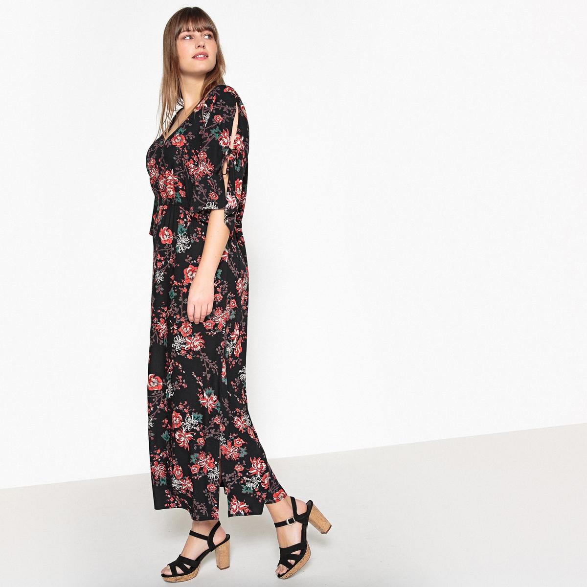 Sukienka w kwiaty z dekoltem w serek