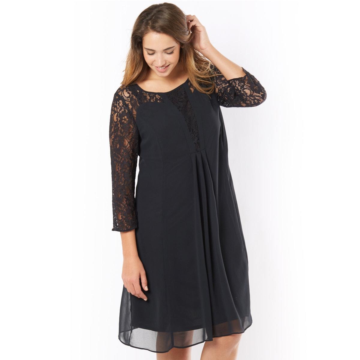 Кружевное платьеКружевное платье. Очень актуальное: кружево! Круглый вырез с кружевом на декольте. Кружевные рукава 3/4 . 100 % полиэстер, подкладка 100 % полиэстр. 3 складки спереди.  V-образное декольте сзади, молния и застёжка. Длина 95 см.<br><br>Цвет: черный