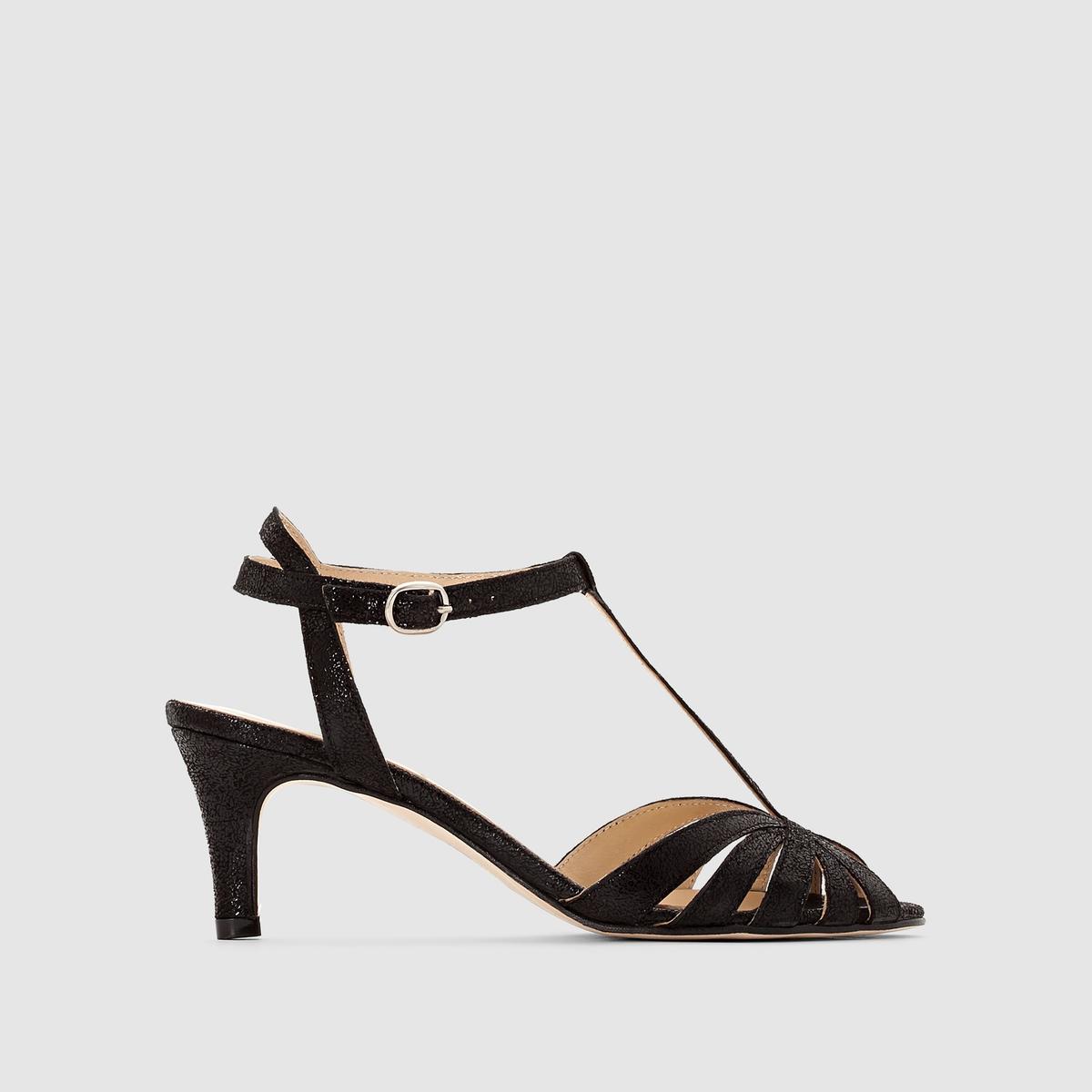 Босоножки из неотделанной велюровой кожи на каблуках JONAKБосоножки из неотделанной кожи JONAK Верх : Неотделанная (телячья) велюровая кожа  (Подкладка : кожа.Стелька : кожа.Подошва : эластомер.Высота каблука : 5 см.Застежка : пряжкаПреимущества: не нужно искать, перед вами босоножки на каблуках из велюровой кожи, которые не оставят вас безразличными благодаря своей боковой пряжке и каблуку необходимой длины для сохранения легендарного комфорта от JONAK.<br><br>Цвет: черный с блеском<br>Размер: 39.41