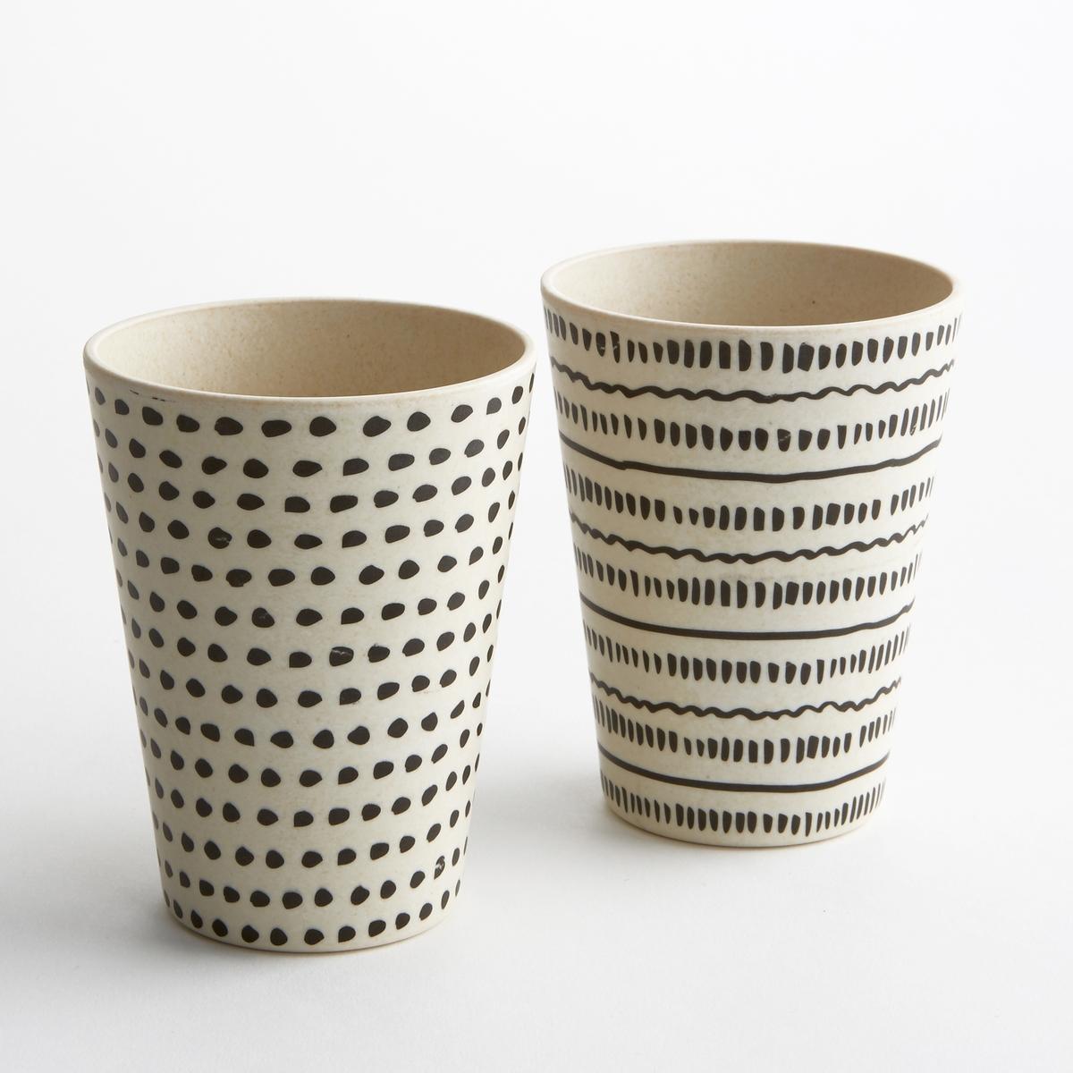 Комплект из 4 стаканчиков из бамбука BamboskaХарактеристики 4 стаканчиков из бамбука с рисунком Bamboska :Бамбук с рисунком, 2 разных узора.Размеры 4 стаканчиков из бамбука с рисунком Bamboskа :Диаметр. 8,3 x 11 см.Бамбук с рисунком, 2 разных узора.Другие стаканчики и наши коллекции предметов декора стола вы можете найти на сайте laredoute.ru<br><br>Цвет: набивной рисунок