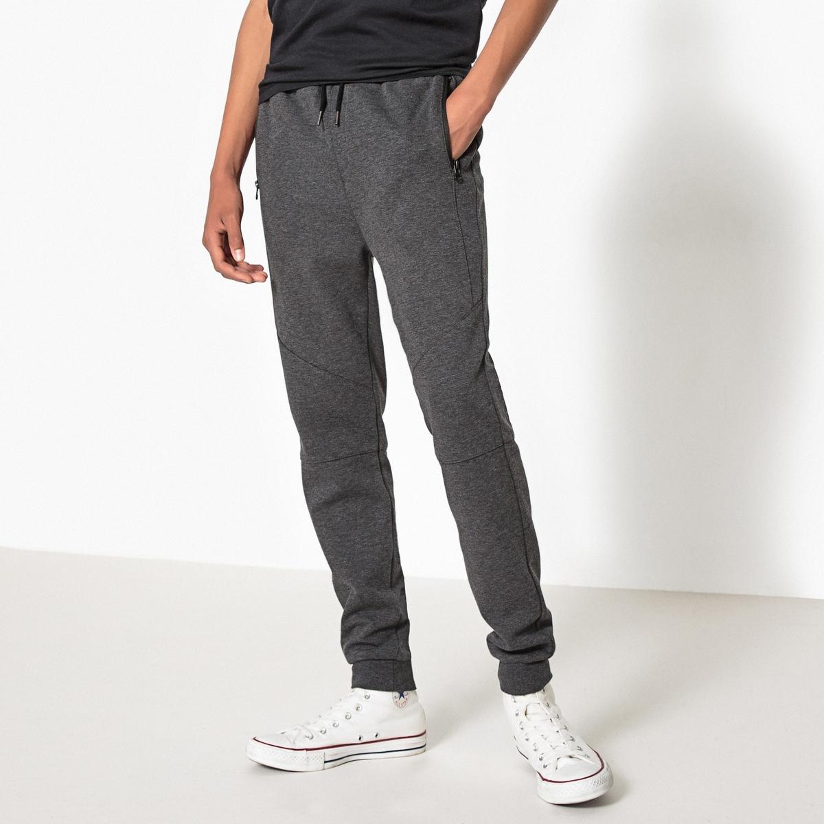 Спортивные брюки 10-16 летСпортивные брюки с эластичным поясом с завязками. 2 кармана на молнии спереди + 1 карман сзади . Вырезы на коленях спереди .Состав и описание :    Материал      75% полиэстера, 25% хлопка  Уход: : - Машинная стирка при 30°C с вещами схожих цветов. Стирка и глажка с изнаночной стороны. Машинная сушка в умеренном режиме. Гладить на низкой температуре.<br><br>Цвет: темно-серый меланж<br>Размер: 10 лет - 138 см.16 лет - 174 см.12 лет -150 см