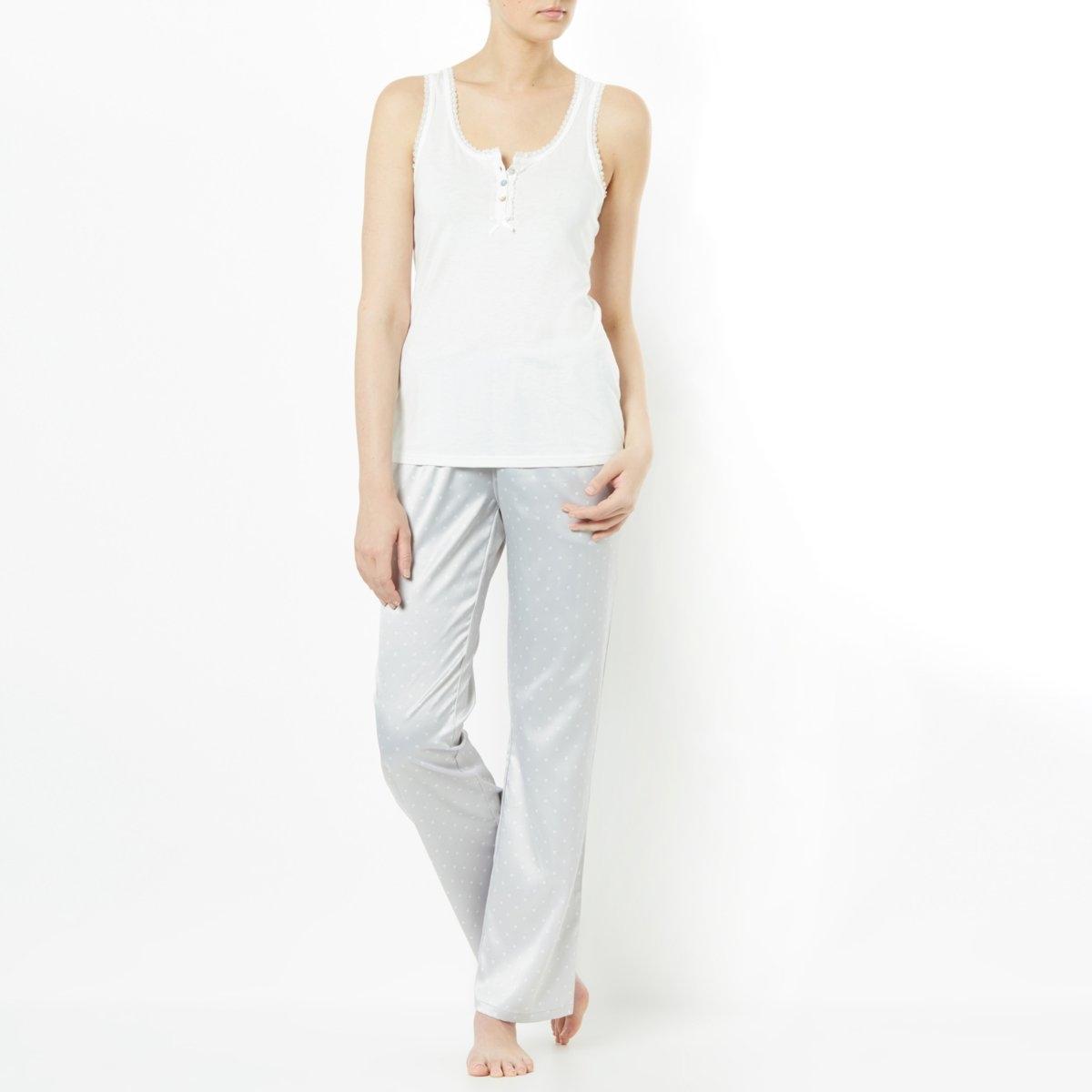 Пижама с атласными брюкамиЭлегантная пижама в игривом стиле с оригинальным сочетанием материалов. Пижама с верхом из джерси: 50% хлопка, 50% модала. Застежка на пуговицы. Длина: 62 см. Брюки из атласа с рисунком: 95% полиэстера, 5% эластана. Пояс с завязками. 2 косых кармана. Длина по внутр.шву 76 см. Машинная стирка при 30°.<br><br>Цвет: белый/серый с рисунком<br>Размер: 50/52 (FR) - 56/58 (RUS)