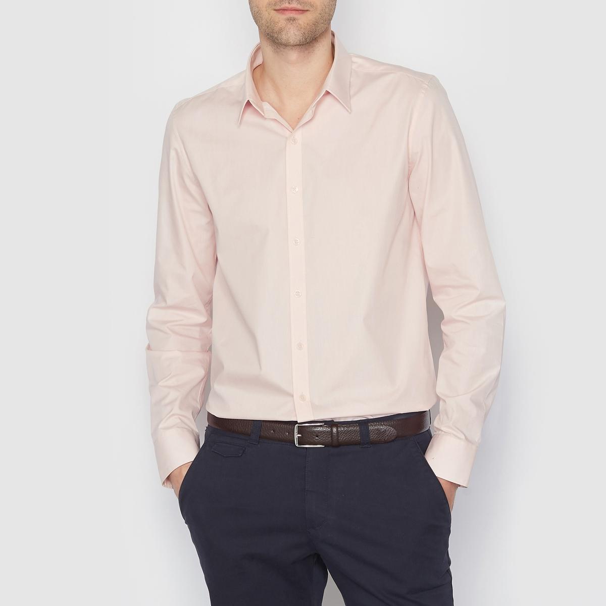 Рубашка однотонная прямого покроя с длинными рукавамиРубашка прямого покроя с длинными рукавами. Длина 77 см.  Низ рукавов с застежкой на пуговицы. 55% хлопка, 45% полиэстера.<br><br>Цвет: светло-розовый<br>Размер: 45/46