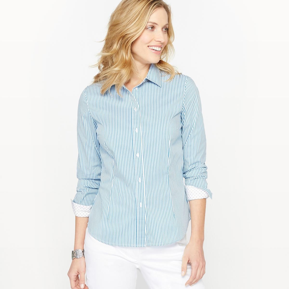 Рубашка в полоску из окрашенных волоконРубашка в полоску из окрашенных волокон. Контрастные внутренняя поверхность воротника, планка застежки на пуговицы и манжеты в горошек бежевого цвета. Длинные рукава, манжеты с застежкой на пуговицы.Состав и описание :Материал : поплин, 69% хлопка, 28% полиамида, 3% эластана.Длина 62 см. Марка : Anne WeyburnУход :Машинная стирка при 40 °С в умеренном режиме.Гладить при низкой температуре.<br><br>Цвет: в бело-синюю полоску<br>Размер: 52 (FR) - 58 (RUS).46 (FR) - 52 (RUS)