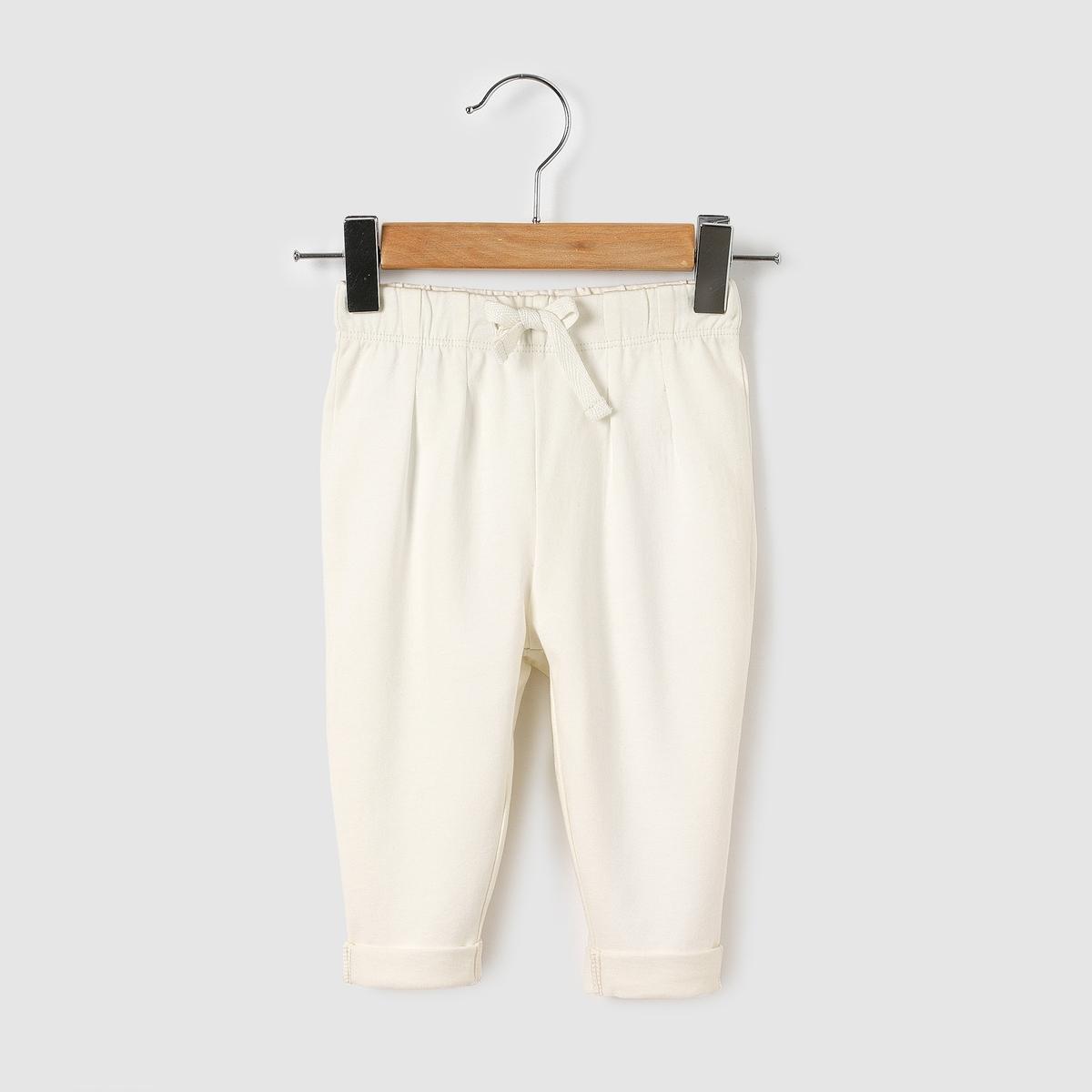 Брюки спортивные из хлопка, 0 мес. - 3 годаСпортивные брюки из джерси. Эластичный пояс, складки спереди и сзади, на завязках. Низ брючин с отворотами. Состав и описание :Материал       80% хлопка, 20% полиэстераМарка       R ?ditionУход :Стирать и гладить с изнаночной стороныМашинная стирка при 40 °C с вещами схожих цветовМашинная сушка в умеренном режимеГладить при средней температуре<br><br>Цвет: серый меланж,экрю<br>Размер: 6 мес. - 67 см.18 мес. - 81 см