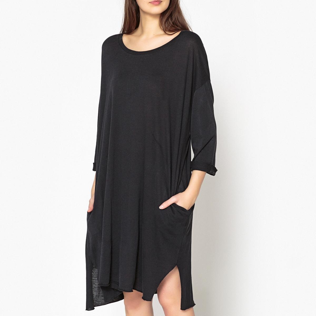 Платье-футболка из струящейся ткани JOCОписание:Платье-футболка AMERICAN VINTAGE - модель JOC. Отвороты на рукавах. Небольшой разрез по низу с каждой стороны. Свободное платье с приспущенными проймами и необработанными краями по низу.Детали •  Форма : расклешенная •  Укороченная модель •  Рукава 3/4    •  Круглый вырезСостав и уход •  50% хлопка, 50% модала •  Следуйте рекомендациям по уходу, указанным на этикетке изделия •  Длина ок.96 см. для размера S<br><br>Цвет: антрацит,хаки<br>Размер: M/L