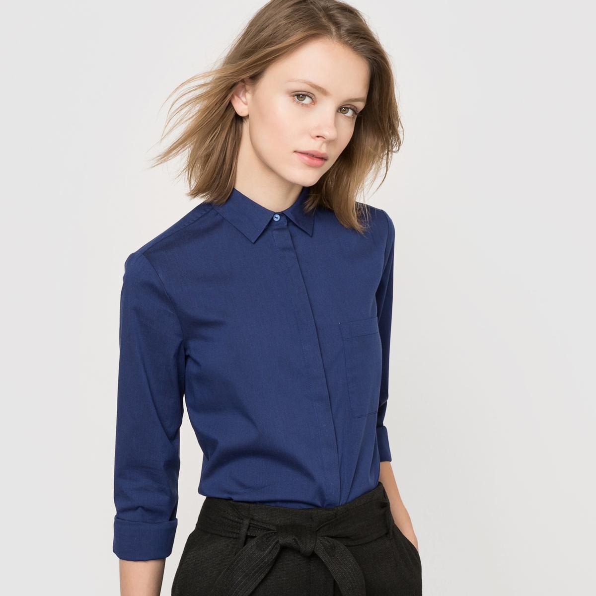 Рубашка однотонная из хлопкового поплина стрейч. Длинные рукава.Рубашка прямого покроя . Однотонный поплин стрейч 69% хлопка, 28% полиамида, 3% эластана. Длинные рукава, манжеты с пуговицами . Накладной нагрудный карман . Закругленный низ . Длина ок.70 см .<br><br>Цвет: темно-синий