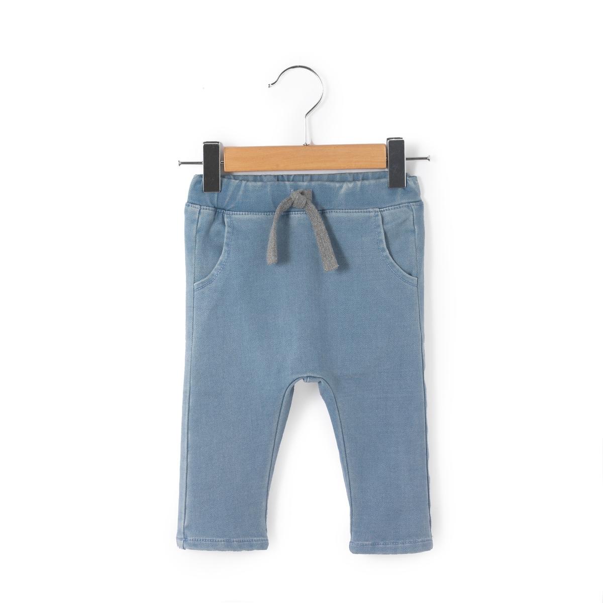 Шаровары из джинсовой ткани, 0 мес. - 3 годаШаровары из джинсовой ткани. Эластичный пояс с завязками. 2 кармана спереди и 2 кармана сзади. Состав и описание : Материал       деним стретч, 56% хлопка, 39% полиэстера, 4% вискозы, 1% эластана Марка       R miniУход :Машинная стирка при 40 °С с вещами схожих цветов.Стирать, сушить и гладить с изнаночной стороны.Машинная сушка в умеренном режиме.Гладить при низкой температуре.<br><br>Цвет: светлый деним<br>Размер: 0 мес. - 50 см.1 год - 74 см.9 мес. - 71 см.6 мес. - 67 см.3 мес. - 60 см.1 мес. - 54 см