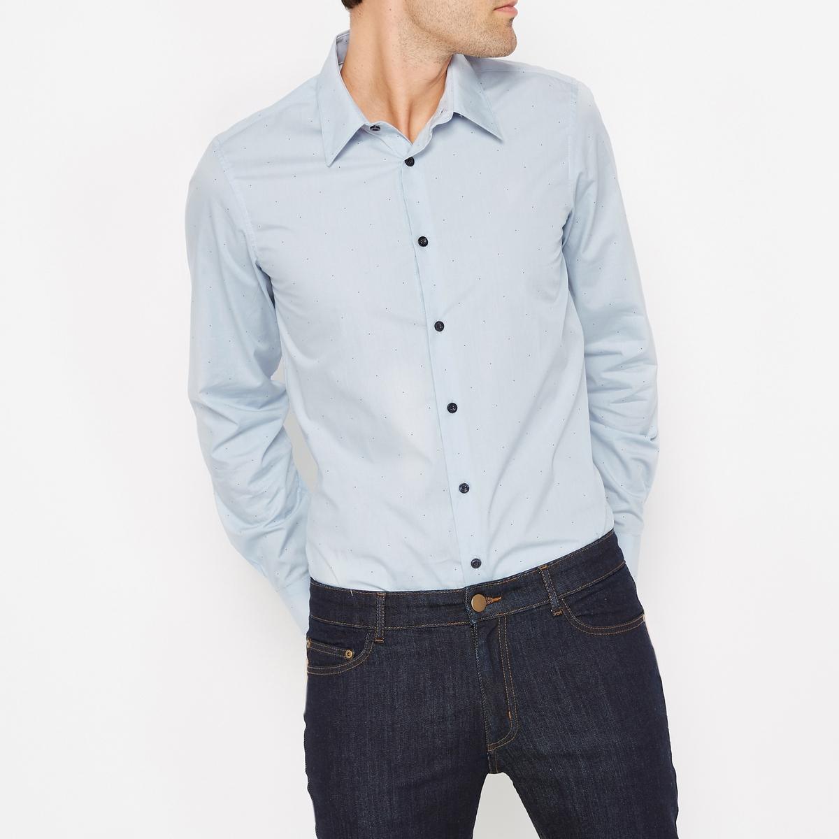 Рубашка узкого покроя в горошекРубашка с рисунком. Зауженный покрой. длинные рукава. Французский воротник с уголками на пуговицах.Состав и описаниеМатериал : 100% хлопок Длина : 79 смМарка : R essentiel.УходМашинная стирка при  40°CСухая (химическая) чистка запрещенаОтбеливание запрещеноСтирка с вещами схожих цветовБарабанная сушка запрещенаГладить на средней температуре<br><br>Цвет: синий/наб. рисунок<br>Размер: 47/48.43/44