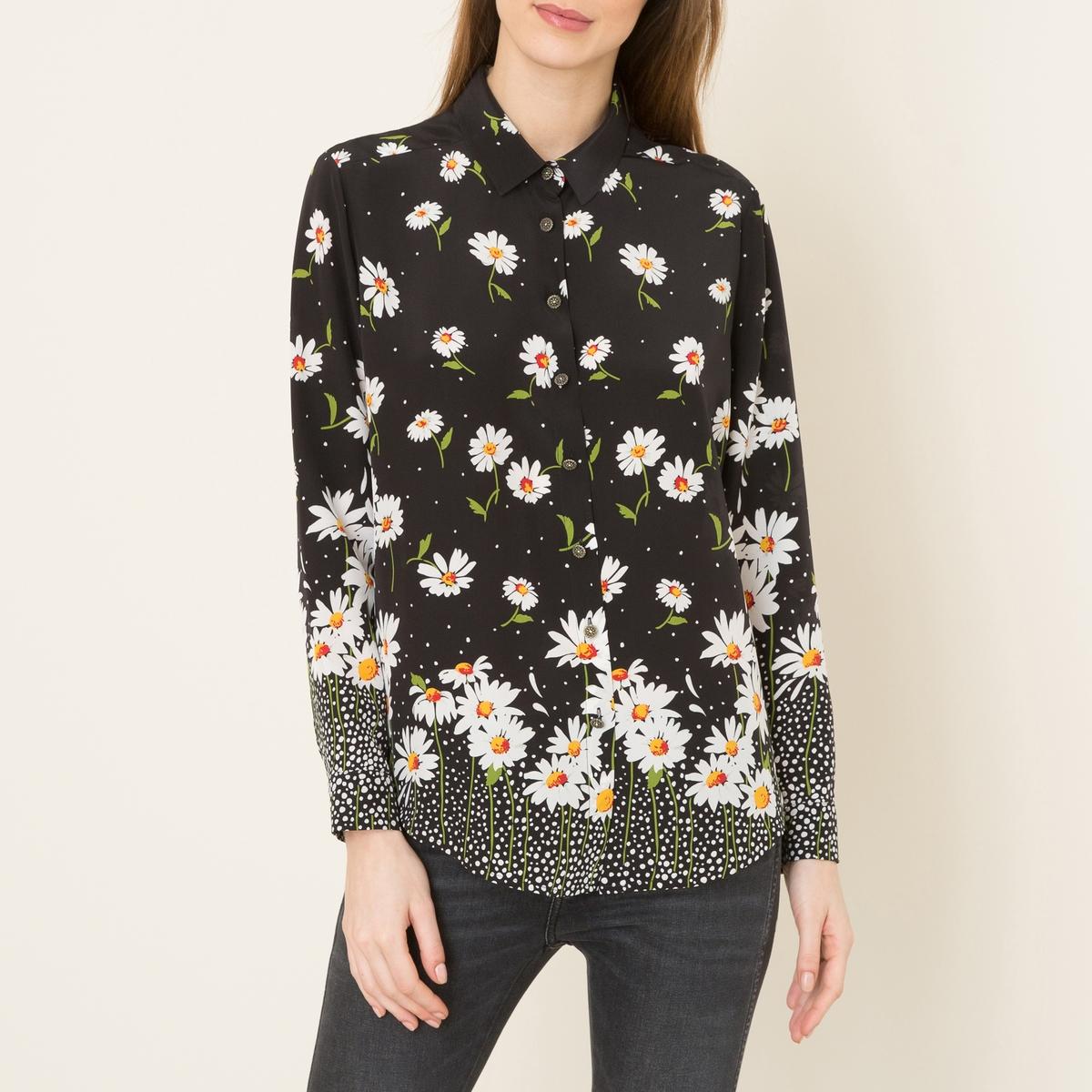 Рубашка шелковаяРубашка THE KOOPLES - из шелка со сплошным принтом и накладным низом . Воротник со свободными уголками. Планка спереди и манжеты с застежкой на пуговицы. Слегка закругленный низ. Состав и описание    Материал : 100% вискоза   Марка : THE KOOPLES<br><br>Цвет: рисунок черный