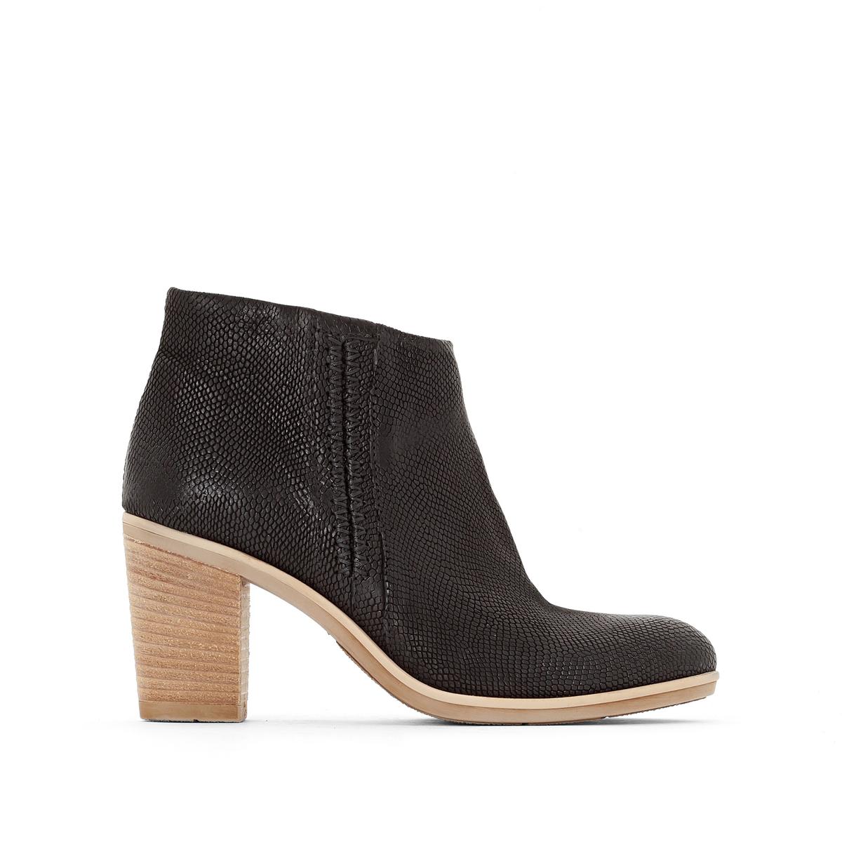 Ботильоны кожаные Melody на каблукеВерх/Голенище: кожа.  Подкладка: кожа.  Стелька: кожа.  Подошва: резина.Высота каблука: 8 см.Форма каблука: широкий каблук.Мысок: закругленный.Застежка: на молнию.<br><br>Цвет: черный<br>Размер: 36