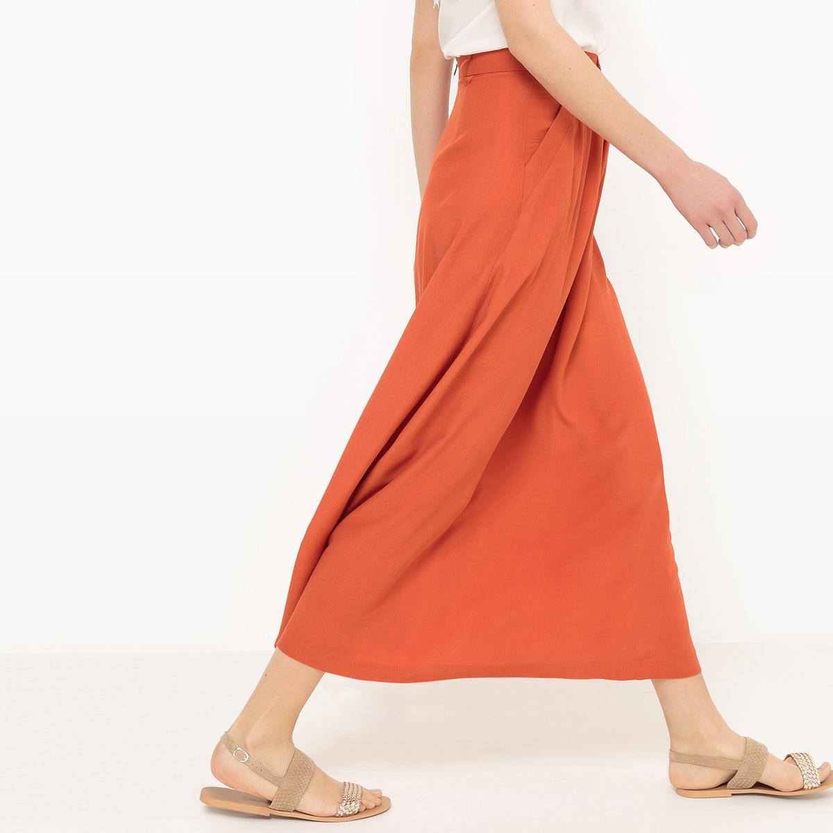 Юбка длинная, расклешенная, однотоннаяМатериал : 100% полиэстер  Рисунок : однотонная модель Длина юбки : удлиненная модель<br><br>Цвет: оранжевый