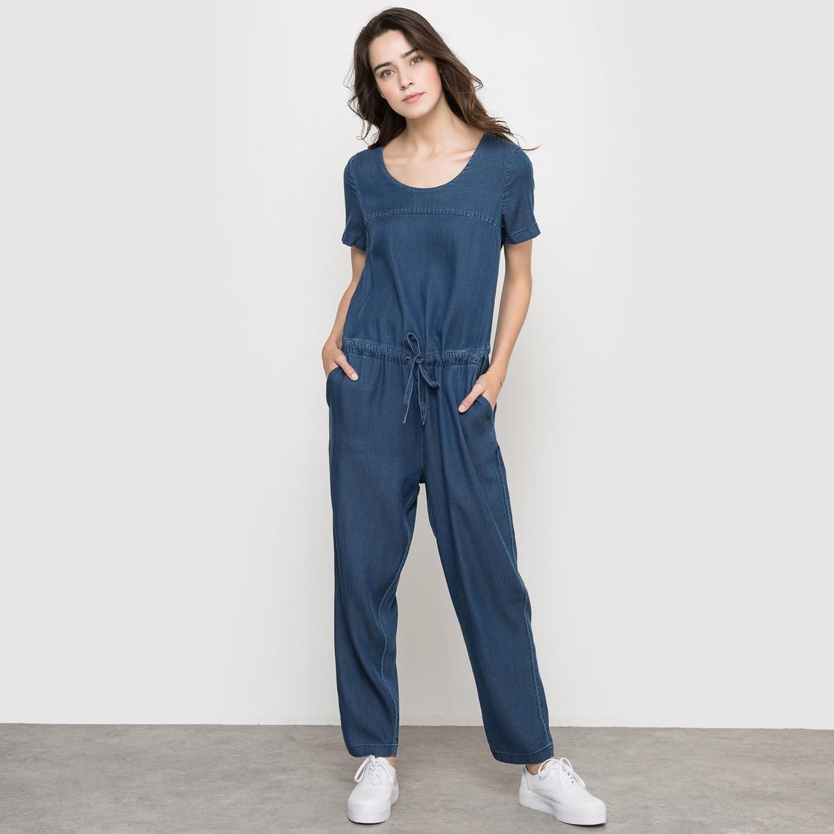 Комбинезон из ткани под джинсуКомбинезон из ткани под джинсу. Легкая ткань, 70% лиосела, 30% хлопка. Короткие рукава. Завязки на талии. Эластичный пояс. 2 боковых кармана . Длина по внутр.шву 68 см . Ширина по низу: 18 см.<br><br>Цвет: синий индиго<br>Размер: XS.S