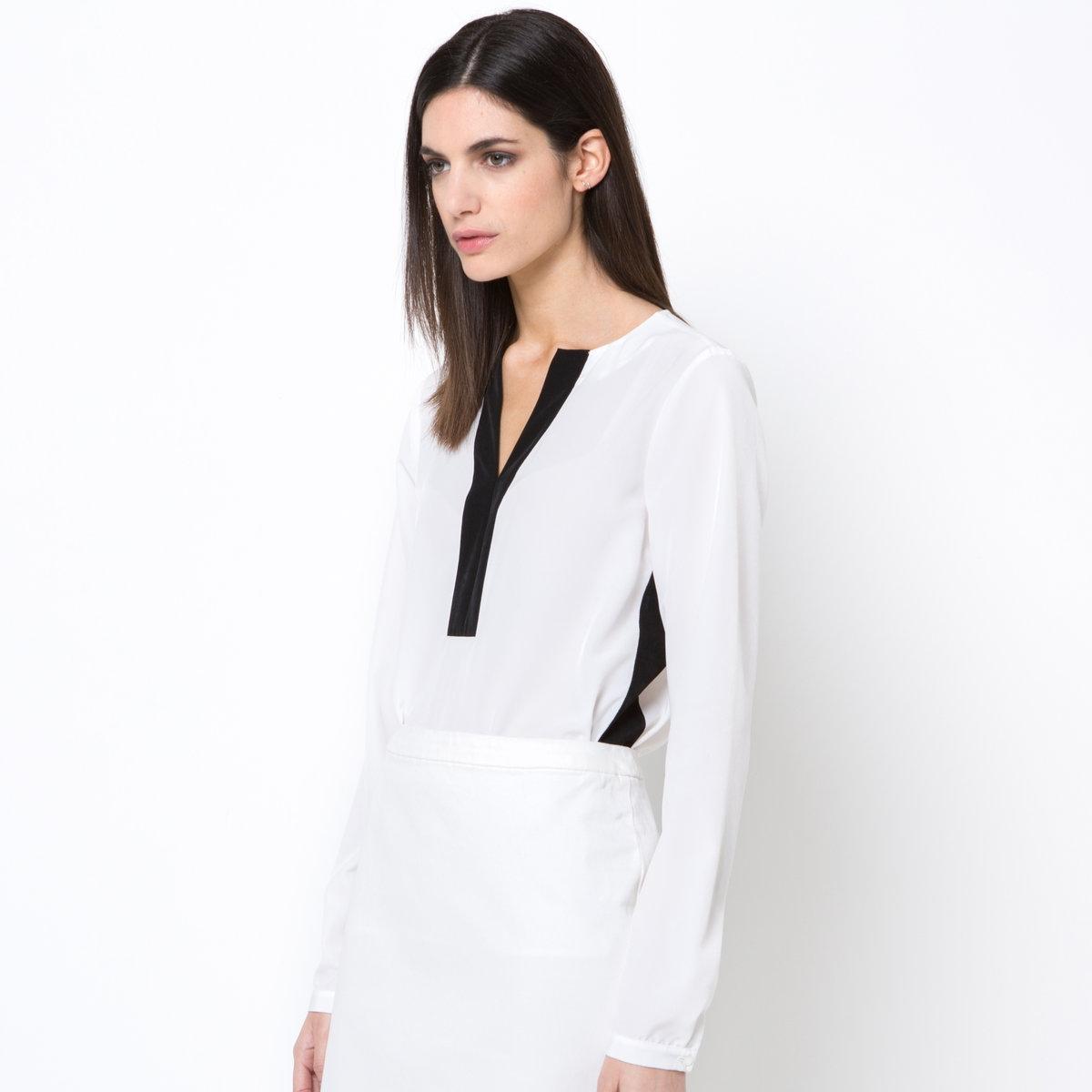 Блузка двухцветнаяДвухцветная блузка. 100% полиэстера. Шлицы по бокам. Контрастные полоски на вырезе и по бокам. V-образный вырез. Длина 60 см.<br><br>Цвет: слоновая кость/ черный<br>Размер: 38 (FR) - 44 (RUS)